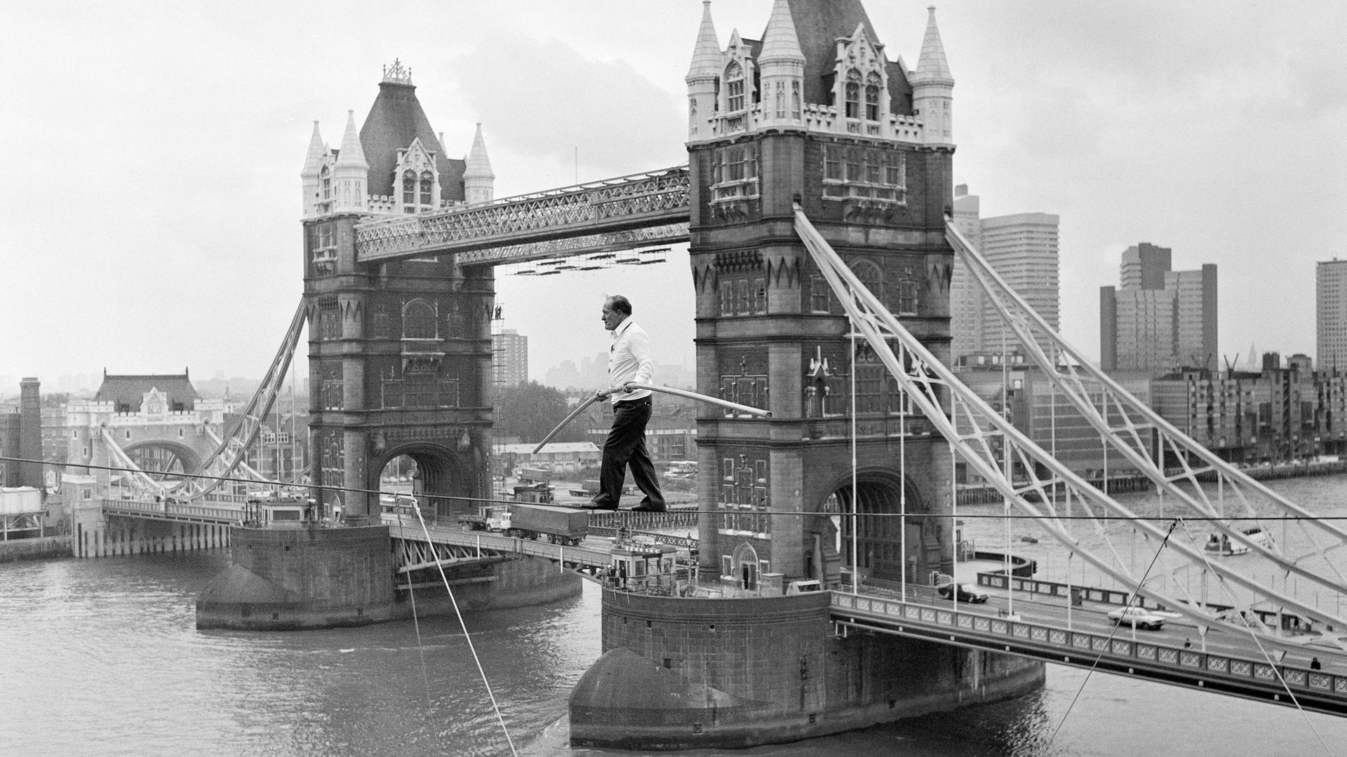 Karl Wallenda on a tightrope 100ft above the ground, near Tower Bridge, London, in 1976 - Credit: Mirrorpix via Getty Images