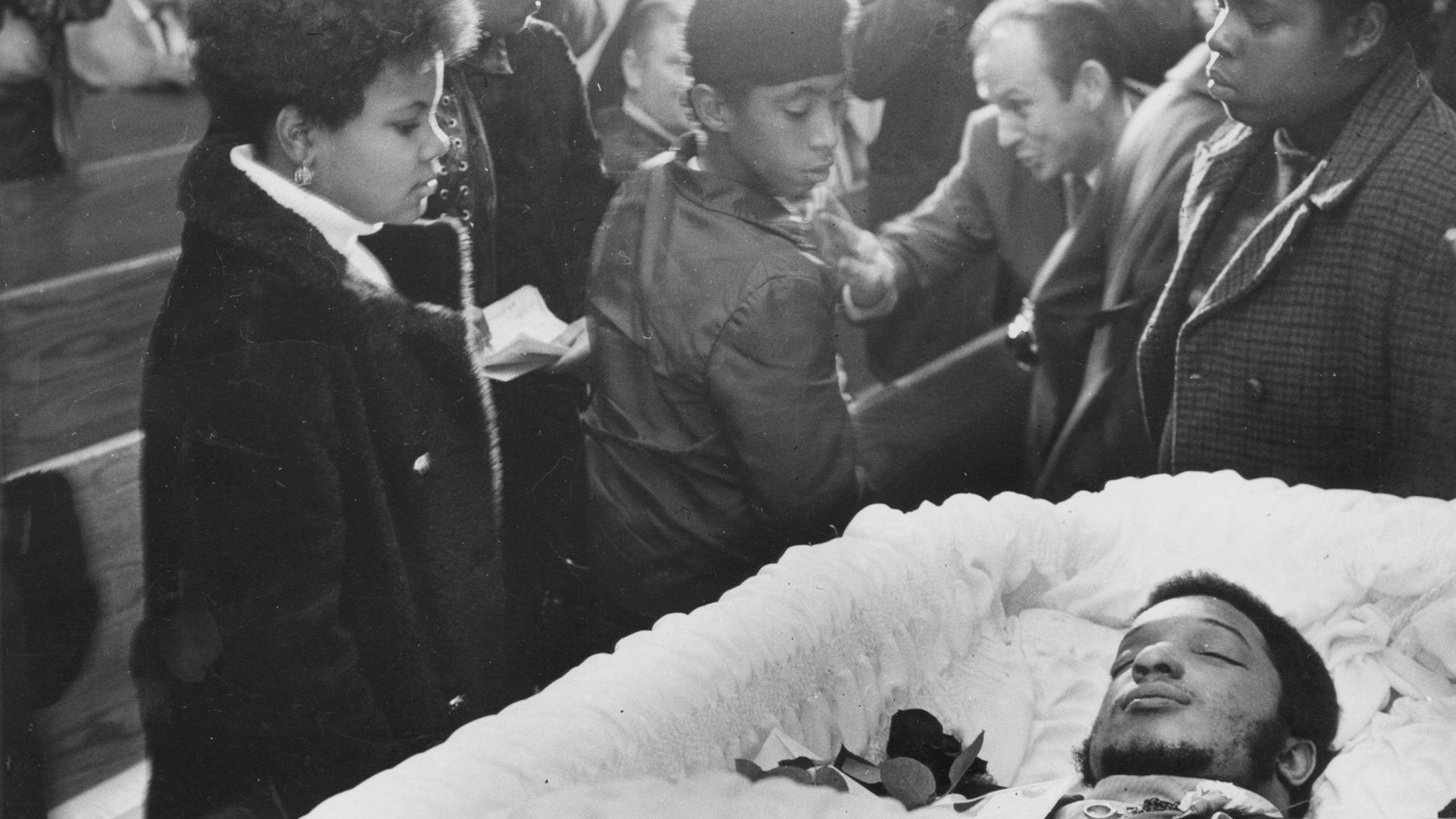 Mourners pass by the coffin of Black Panthers leader Fred Hampton at his memorial service at First Baptist Church of Melrose Park, Melrose Park, Illinois, December 9, 1969. Hampton was killed during a police raid on Dec. 4, 1969 - Credit: Ray Foster/Chicago Tribune/Tribune News Service via Getty Image