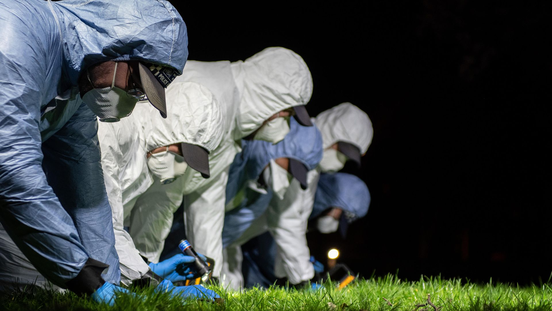 SEARCHING: Police officers conduct a fingertip search near the spot in south London where Sarah Everard was last seen - Credit: Getty Images