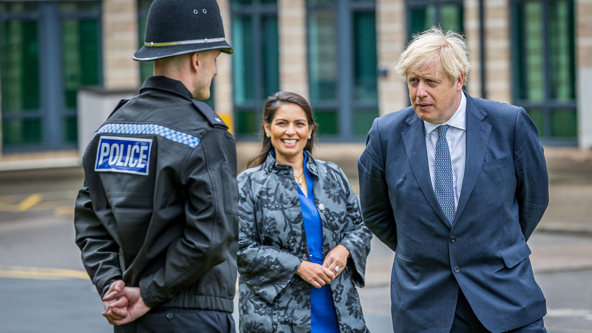 Prime Minister Boris Johnson and Home Secretary Priti Patel are introduced to recently graduated Police Officers - Credit: PA