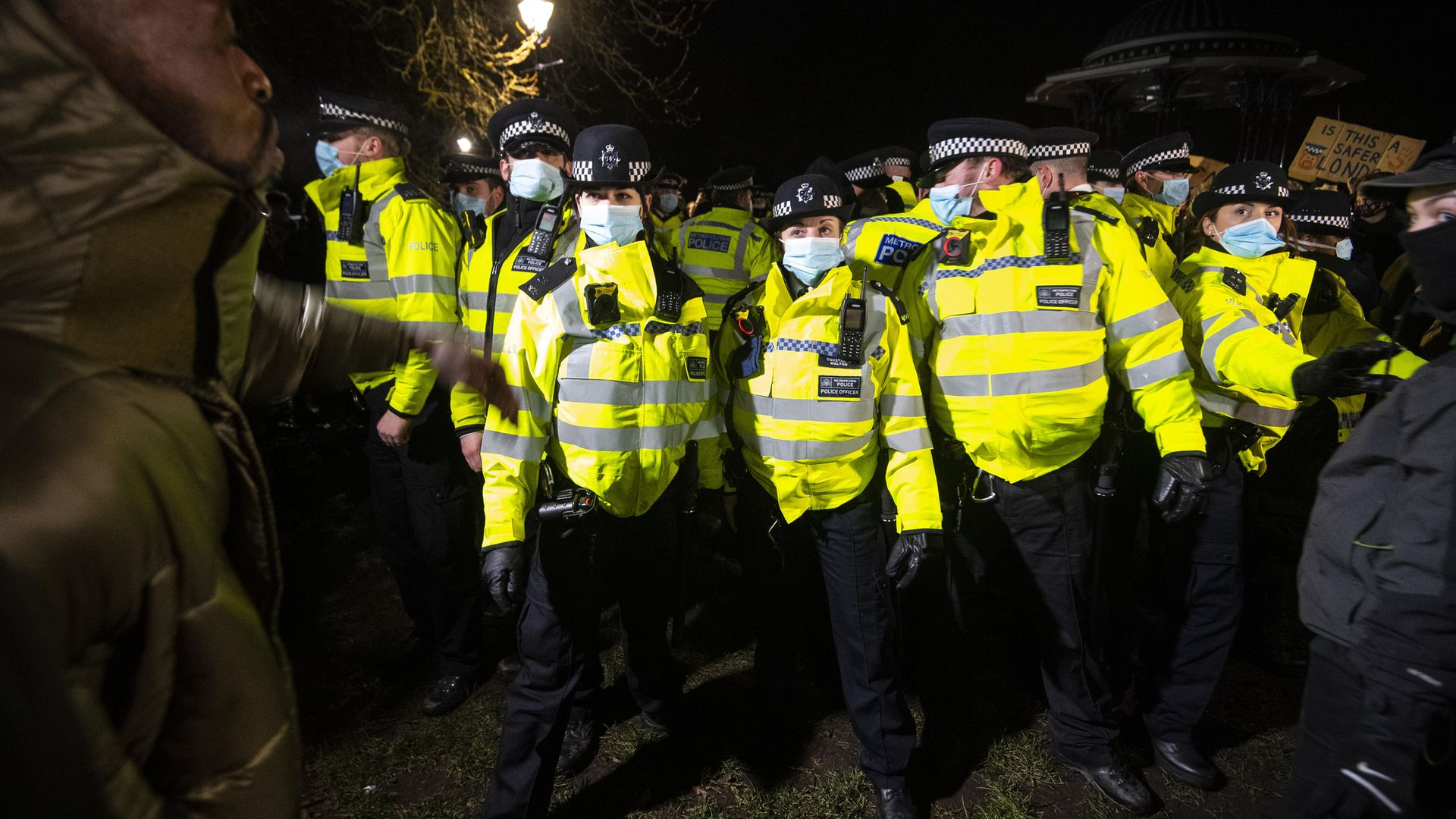 People clash with police as they gather in Clapham Common, London, after the Reclaim These Streets vigil for Sarah Everard was officially cancelled - Credit: PA