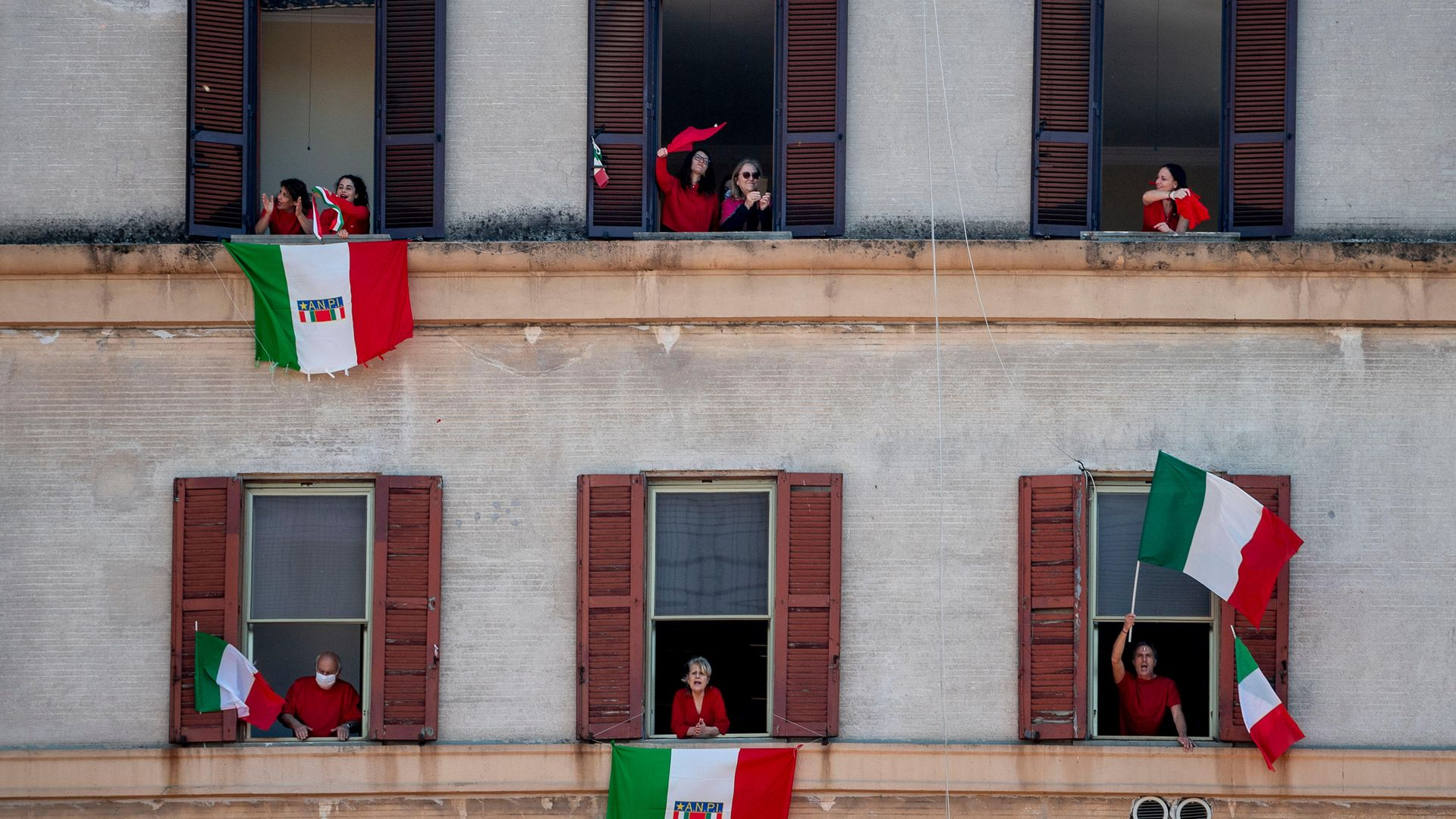 Residents in Rome take part in a communal singing event, during Italy's first lockdown, in April 2020 - Credit: Getty Images