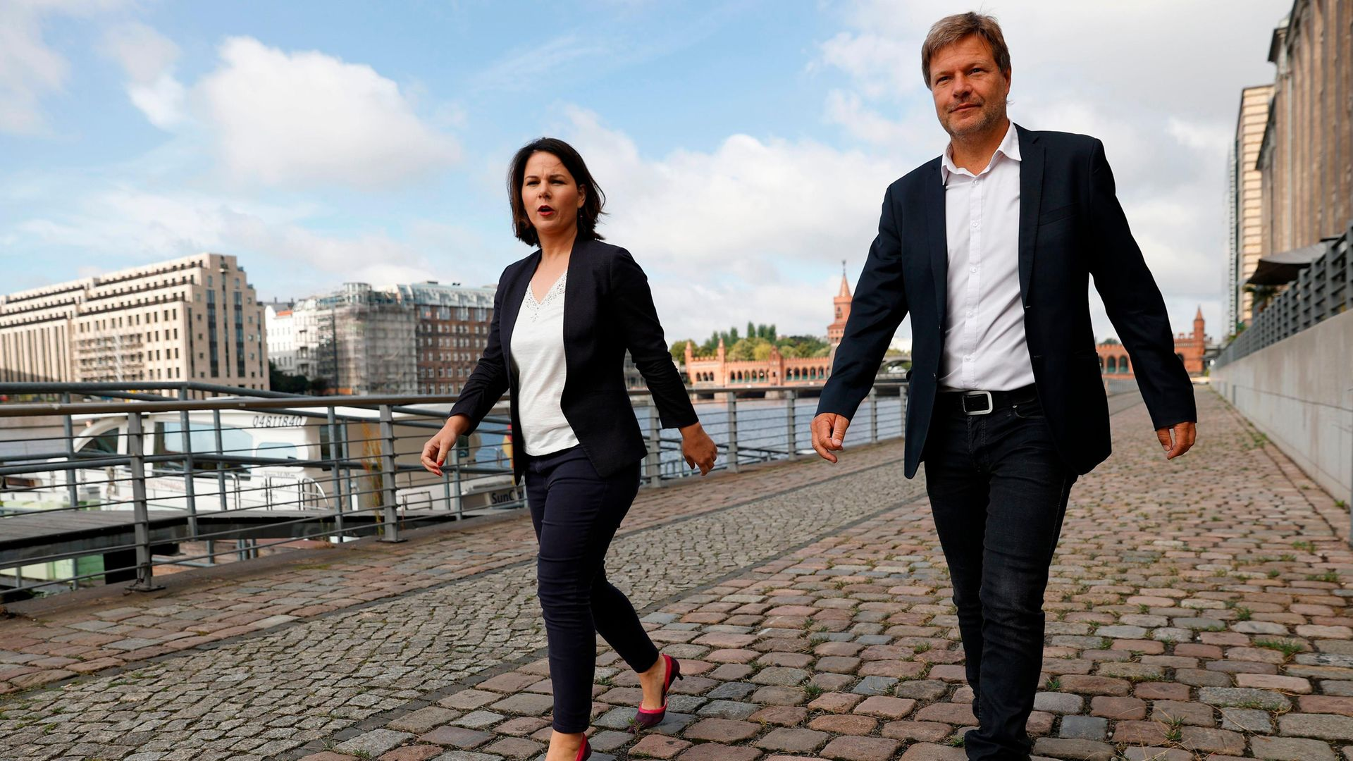 Co-leaders of Germany's Green Party Annalena Baerbock and Robert Habeck walk along Berlin's river Spree - Credit: AFP via Getty Images