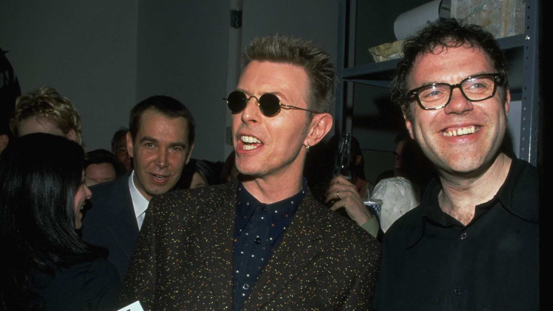 Jeff Koons, David Bowie and William Boyd at the launch of the fictive biography of Nat Tate - Credit: Corbis via Getty Images