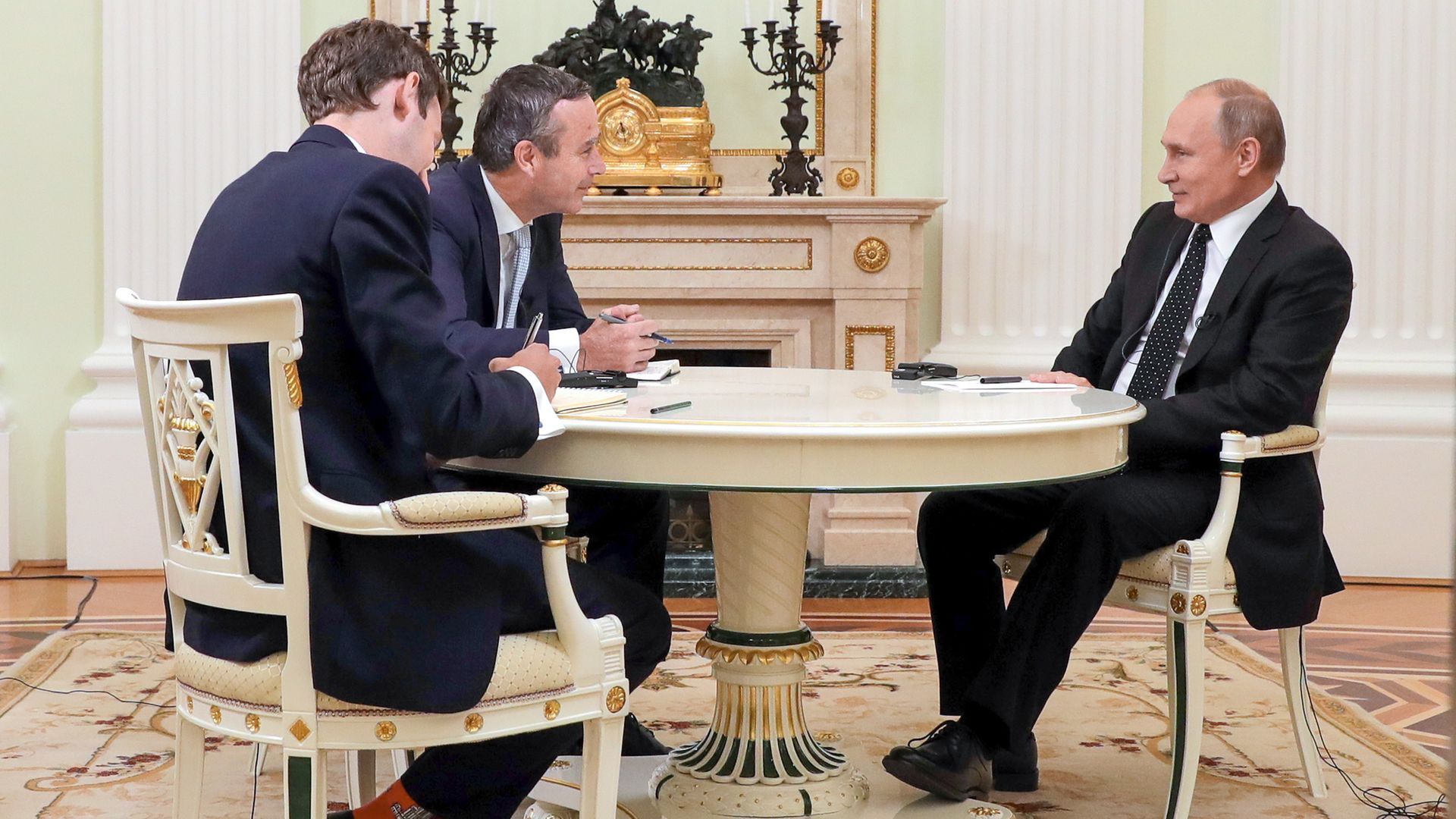 Lionel Barber, centre, and Henry Foy, left, interview Vladimir Putin in Moscow in June 2019 - Credit: Mikhail Klimentyev/TASS