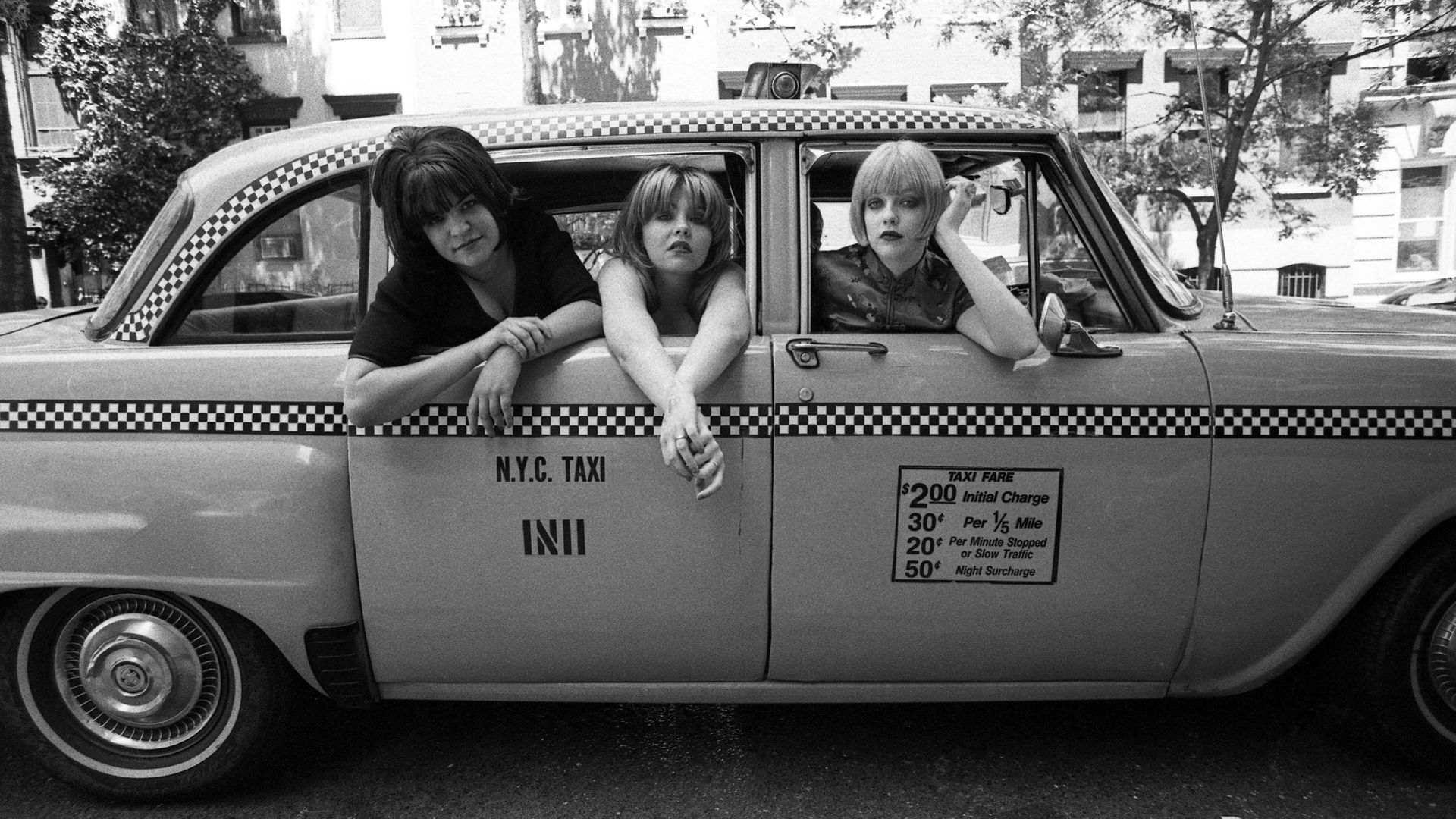 Kenickie in a New York taxi in 1997. From left: Emmy-Kate Montrose, Marie Du Santiago and Lauren Laverne - Credit: Getty Images