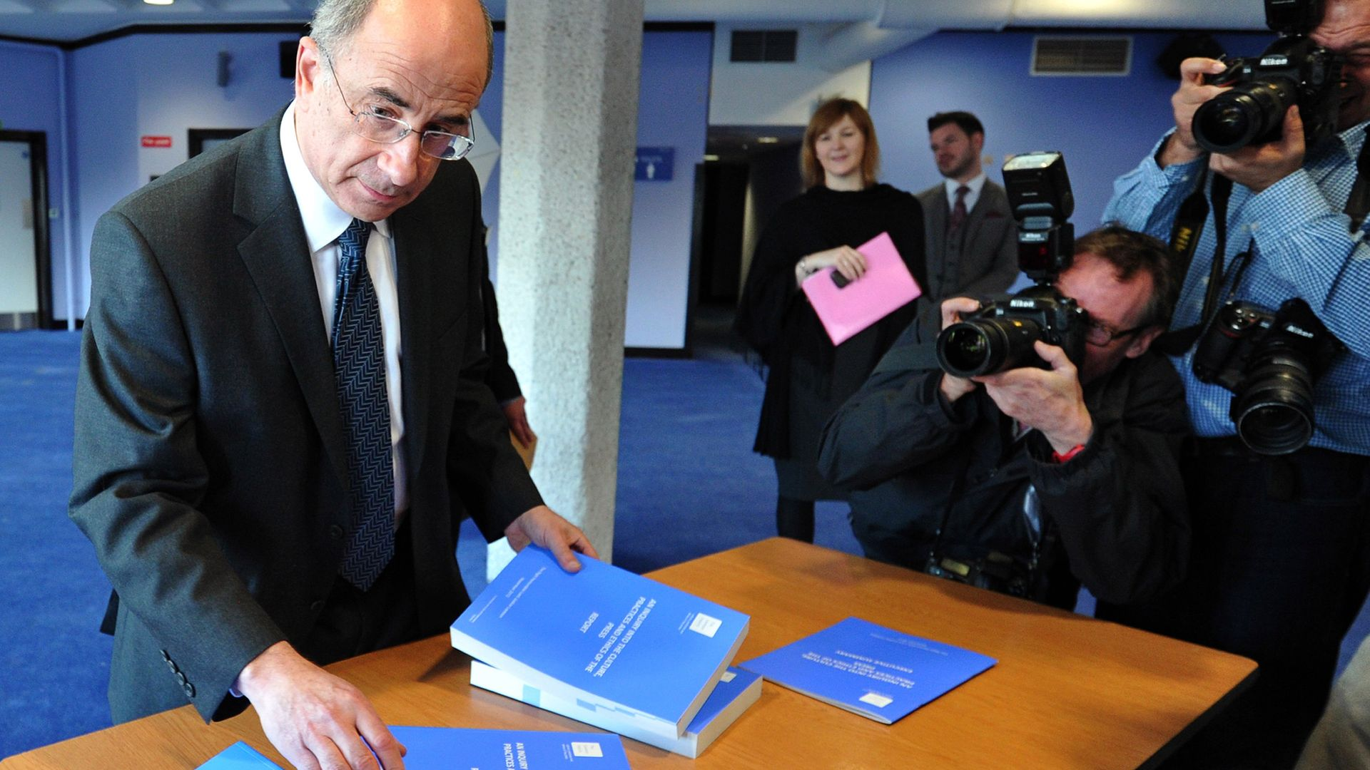 Lord Justice Leveson arranges copies of the Summary of the Leveson Report. Photo: Carl Court/AFP via Getty Images - Credit: AFP via Getty Images
