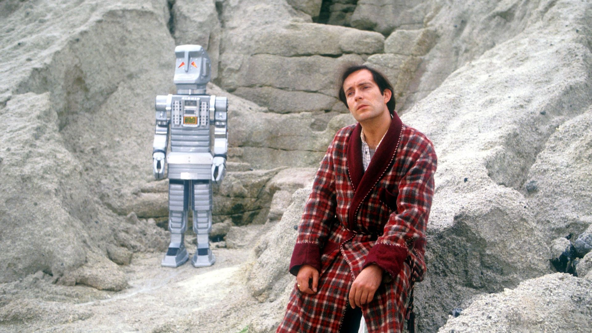 Simon Jones, as Arthur Dent in the BBC's 1981 series The Hitchhiker's Guide to the Galaxy - Credit: BBC