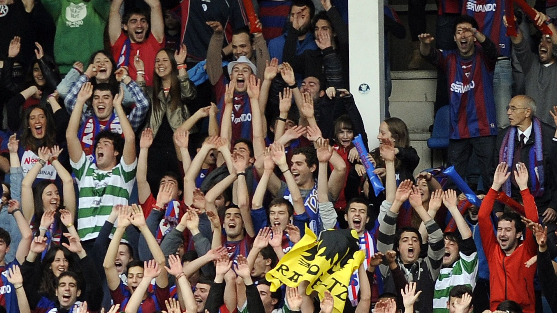 Basque flags and Celtic shirts can be seen as Eibar's fans celebrate during the team's promotion campaign in 2014 - Credit: AFP via Getty Images