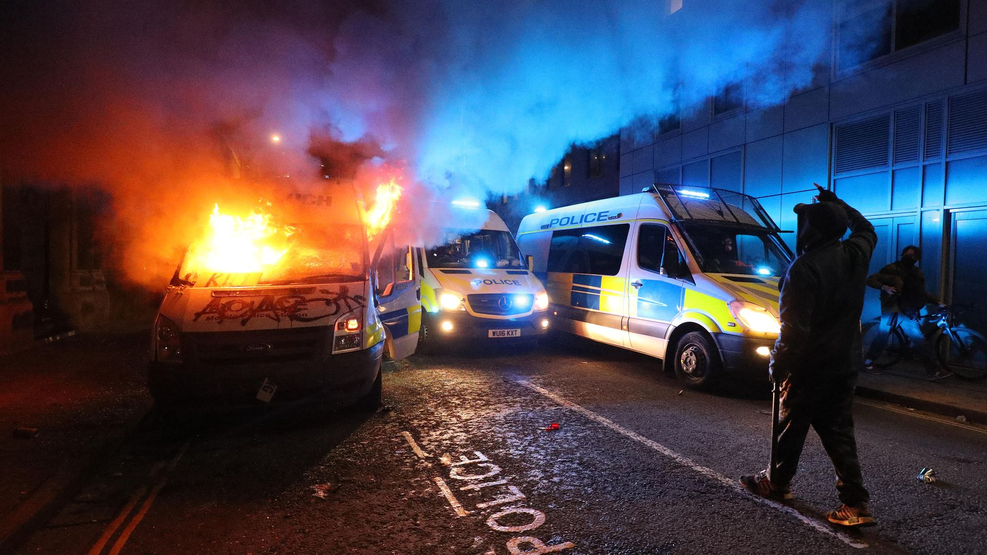 A vandalised police van on fire outside Bridewell Police Station, as other police vehicles arrive after protesters demonstrated against the Government's controversial Police and Crime Bill - Credit: PA
