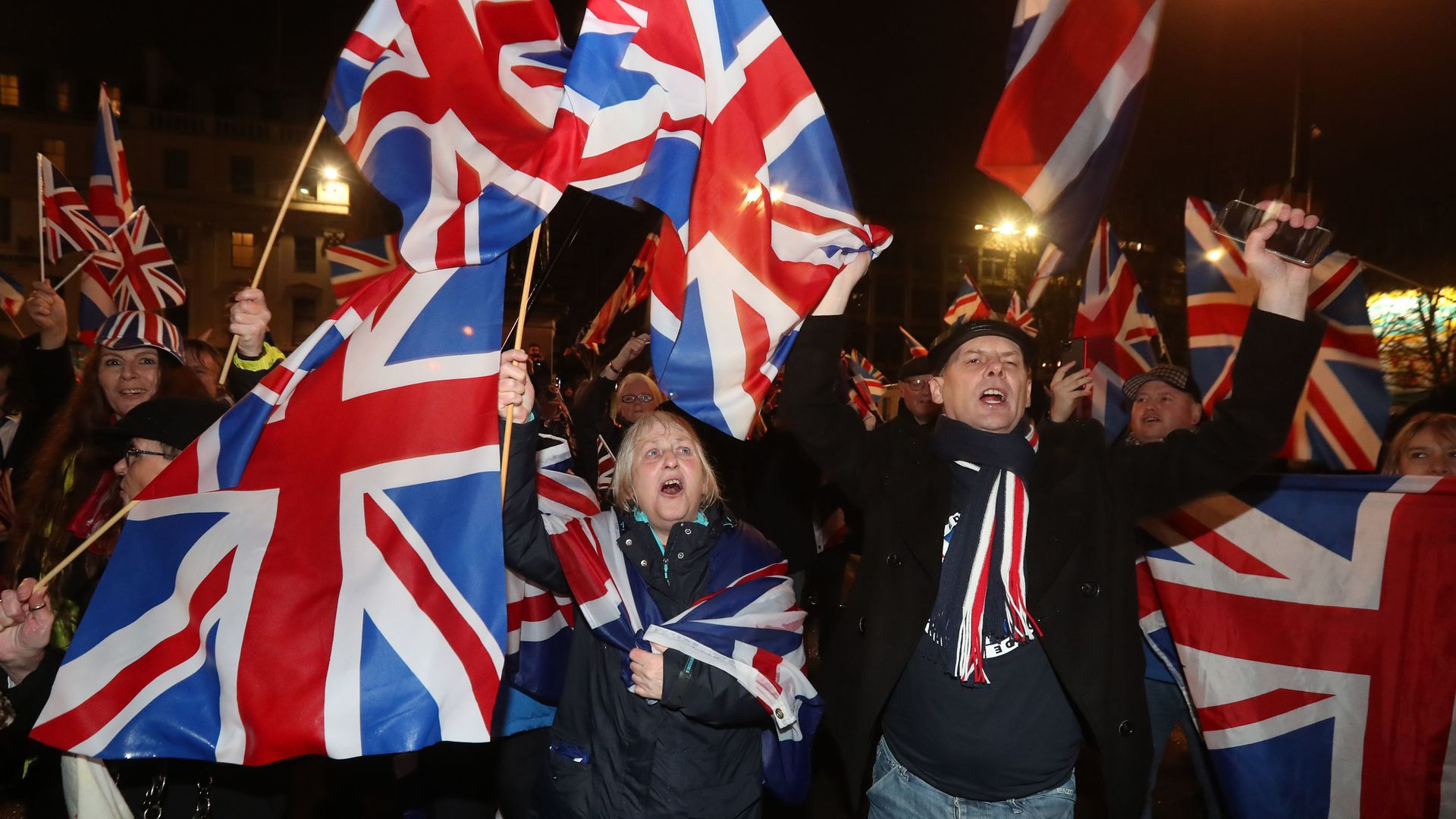 Pro-Brexit supporters gather in George Square, Glasgow, as the UK prepared to leave the European Union on January 31 last year - Credit: PA