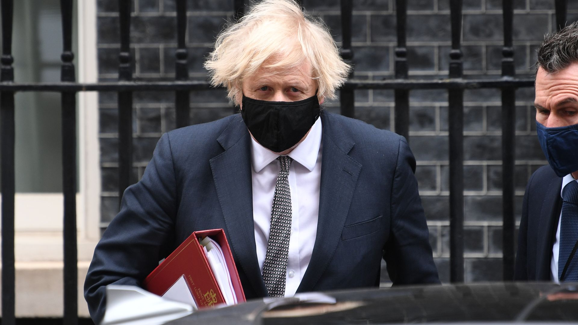 Prime minister Boris Johnson leaves 10 Downing Street to attend Prime Minister's Questions at the Houses of Parliament - Credit: PA