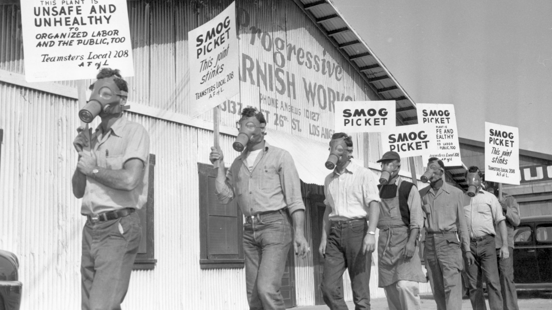 """Protesters complain about the stench from a Los Angeles varnish factory in 1949. Their slogan was """"this joint stinks!"""" - Credit: Bettmann Archive"""