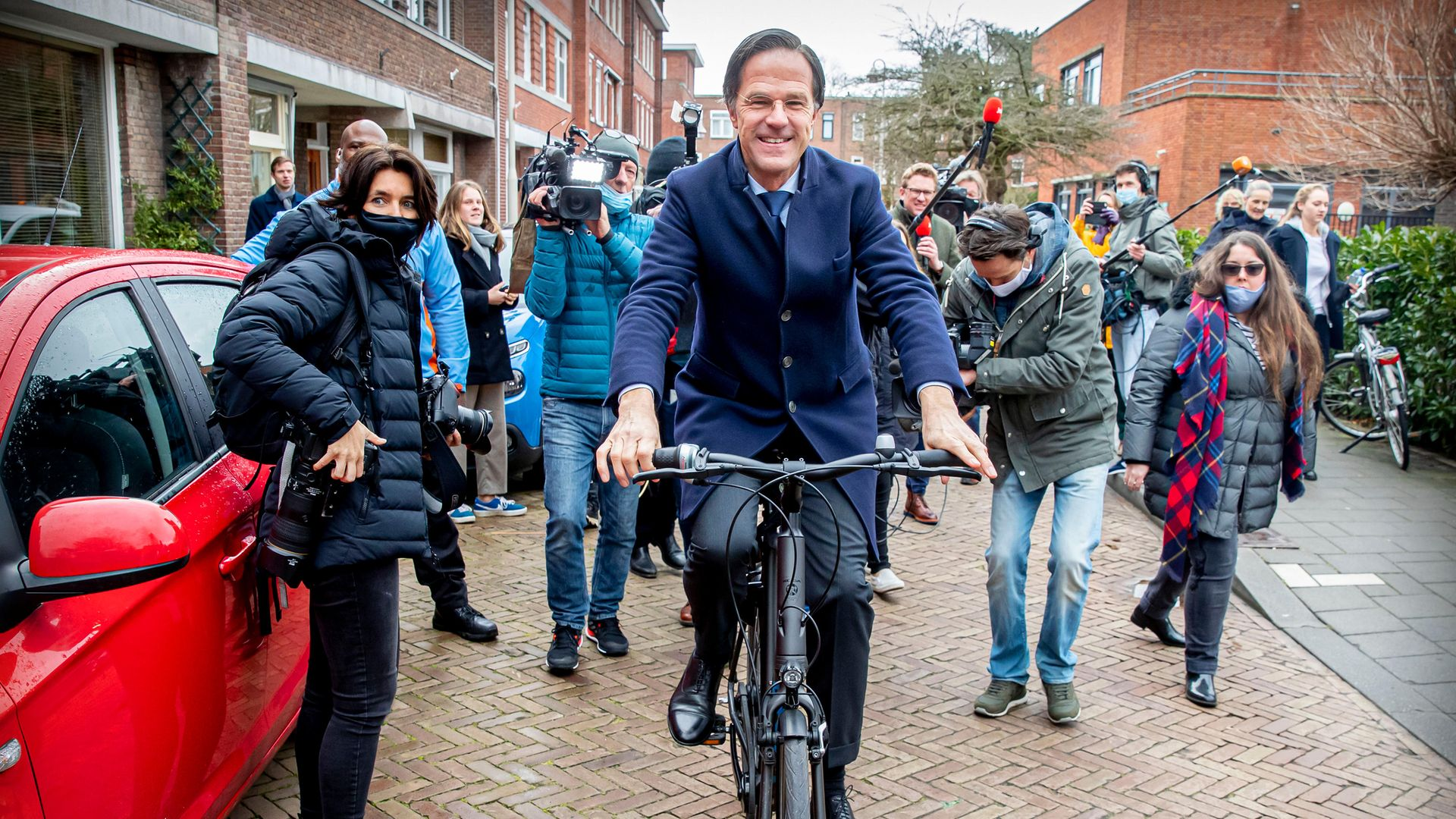 Mark Rutte cycles to the polling station in the recent Netherlands election, which was won by his party - Credit: Getty Images
