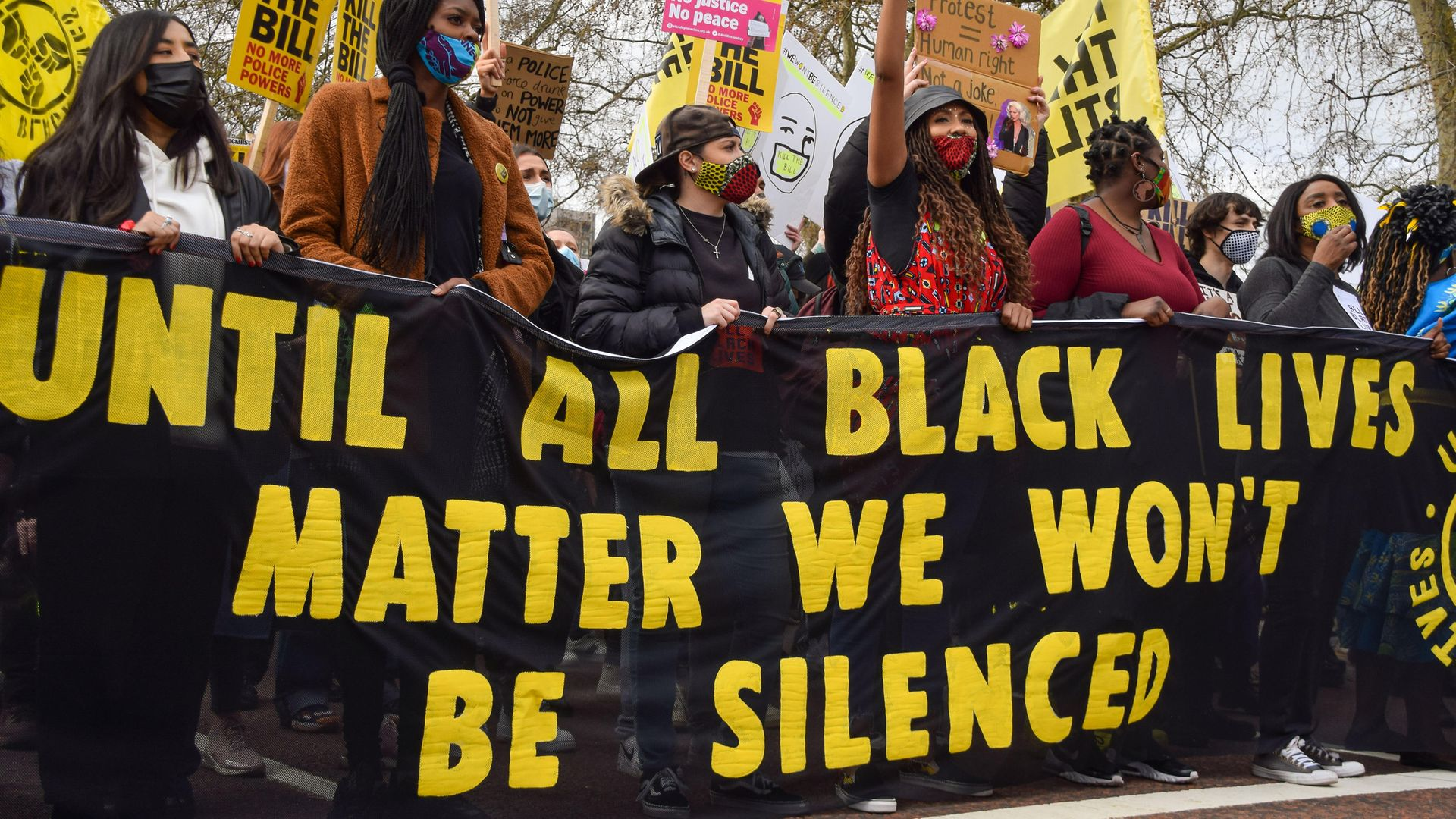 Black Lives Matter protesters hold a banner as they take part during the Kill The Bill march outside Buckingham Palace, April 3, 2021 - Credit: Photo by Vuk Valcic/SOPA Images/LightRocket via Getty Images