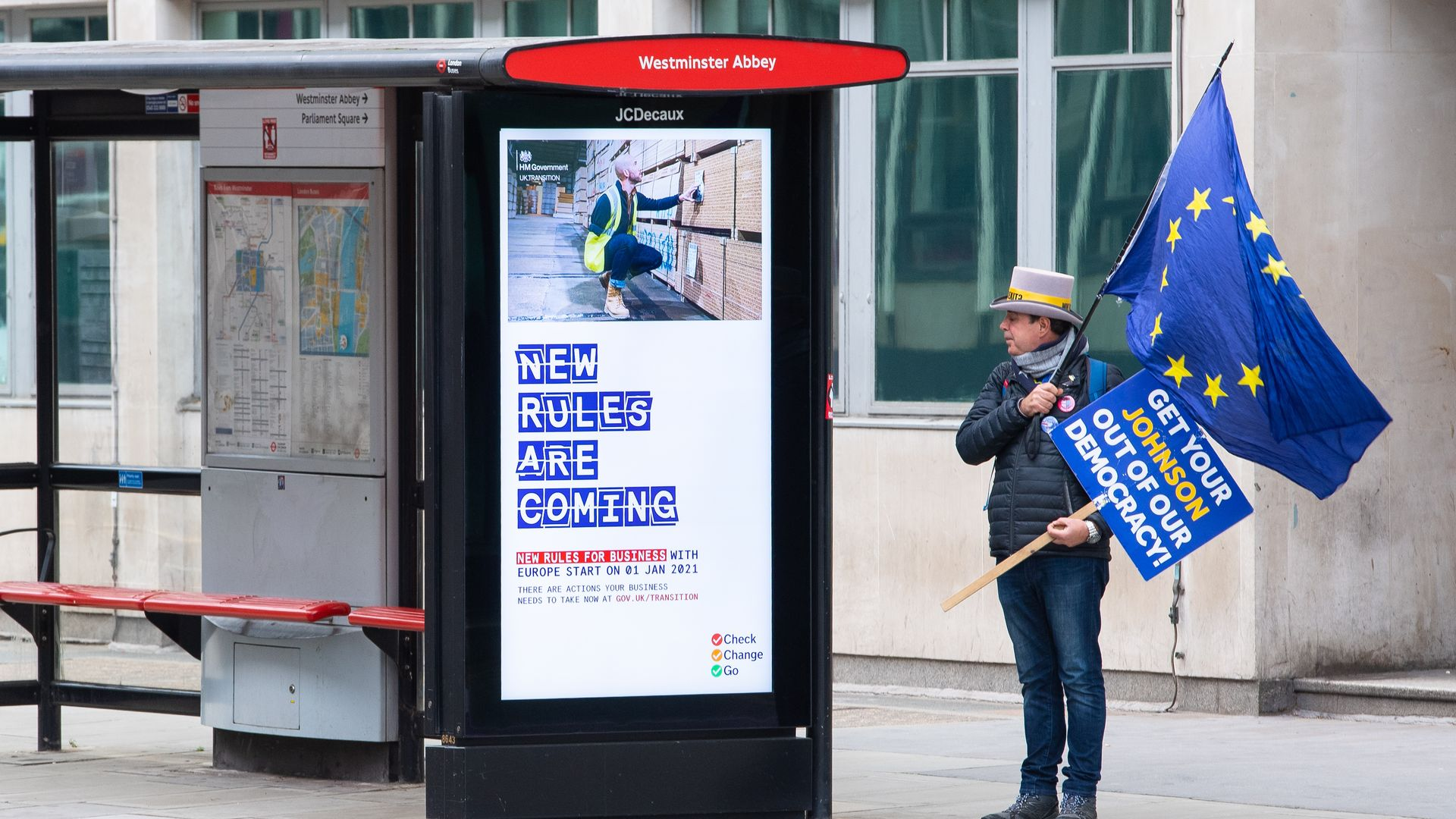 An anti Brexit protestor stands at a bus stop near the Department for Business, Energy and Industrial strategy, in Westminster, London - Credit: PA