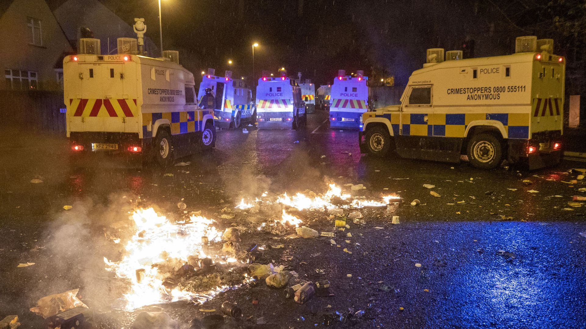 PSNI Tactical Support Group (TSG) officers in attendance at the Loyalist Nelson Drive Estate in the Waterside of Derry City, Co. Londonderry - Credit: PA