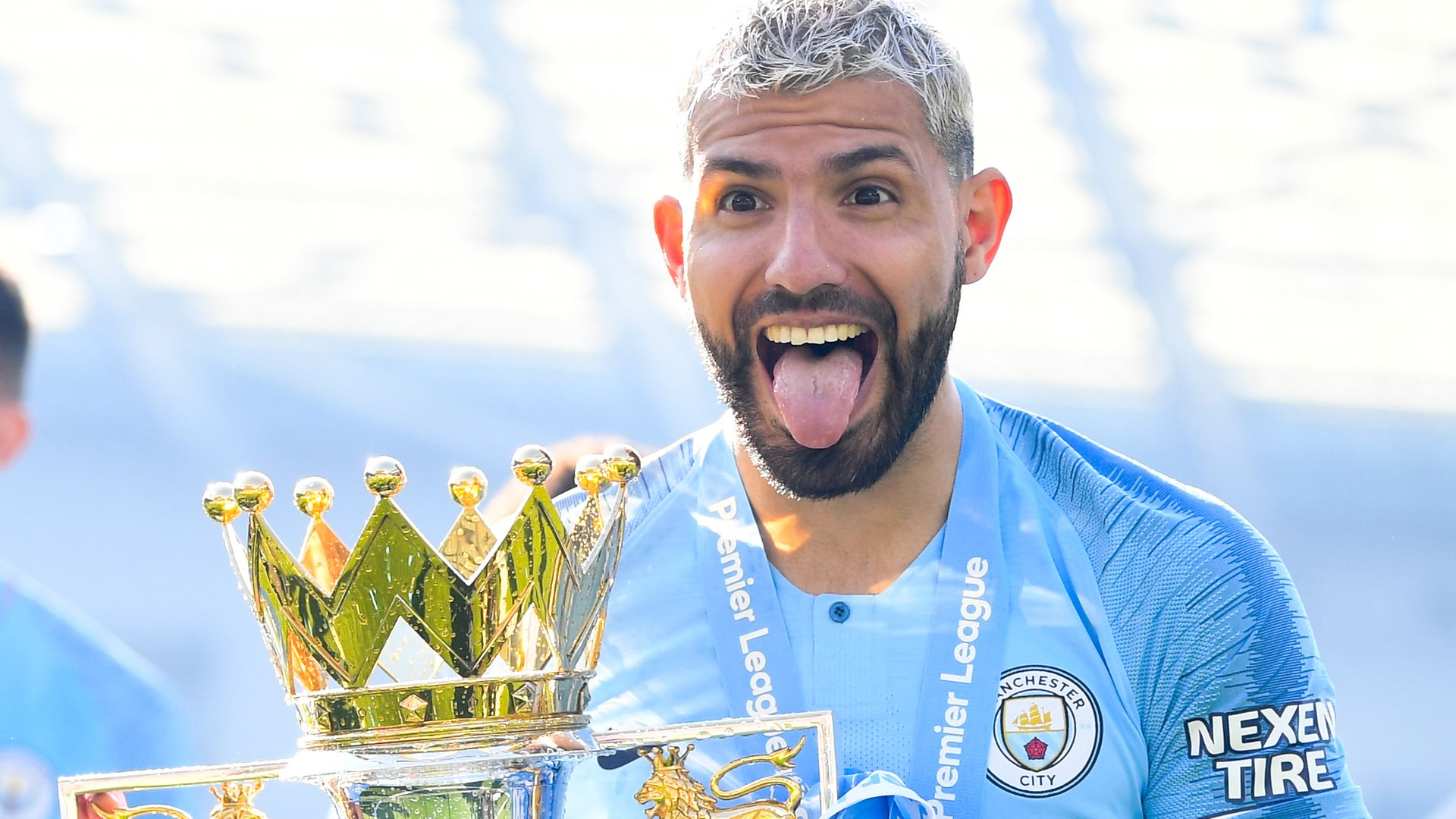 Sergio Aguero celebrates with the Premier League trophy after Manchester City clinched the Premier League title by beating Brighton on May 12, 2019 - Credit: Photo by Michael Regan/Getty Images