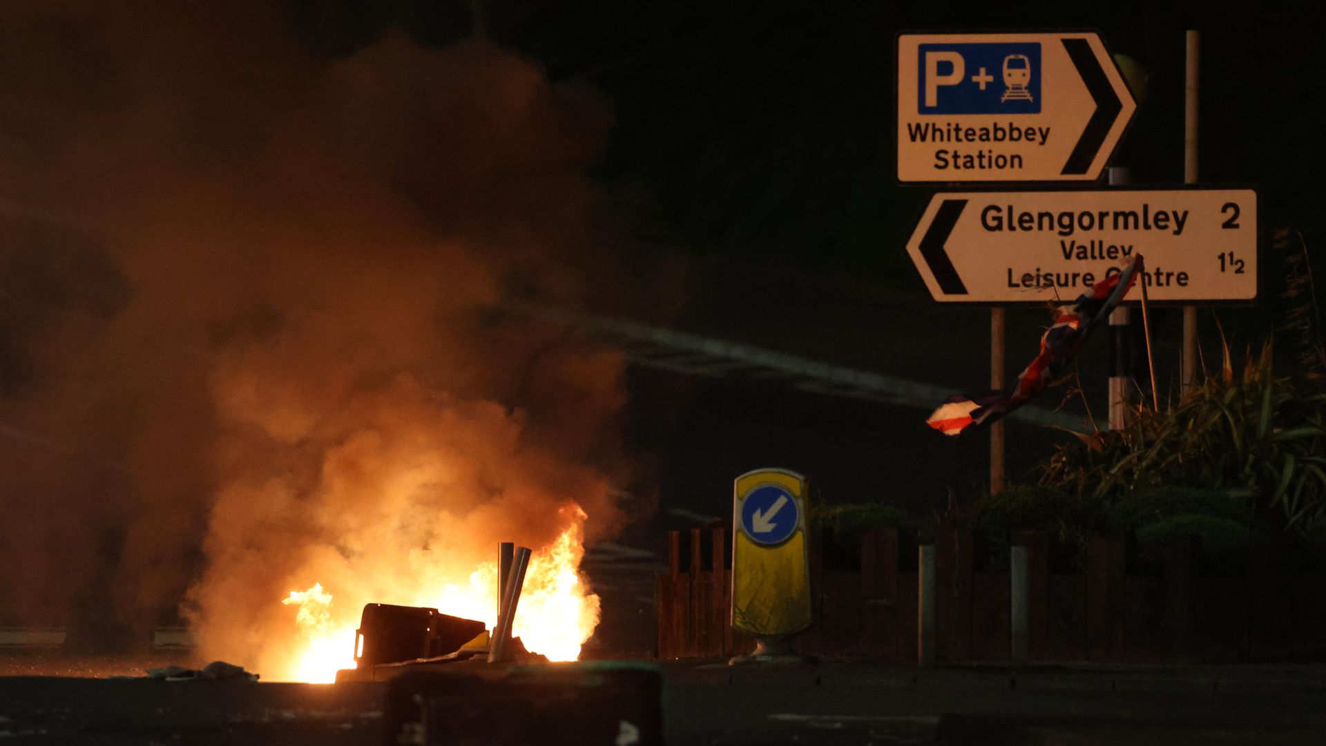 Bins are set ablaze at the Cloughfern roundabout in Newtownabbey - Credit: PA