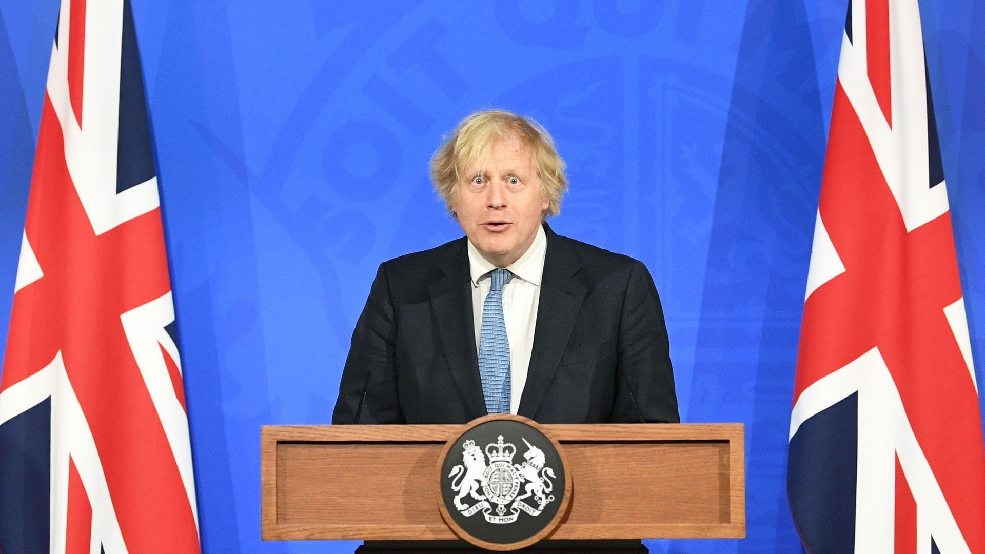 Prime minister Boris Johnson during a coronavirus press briefing broadcast on TV - Credit: PA