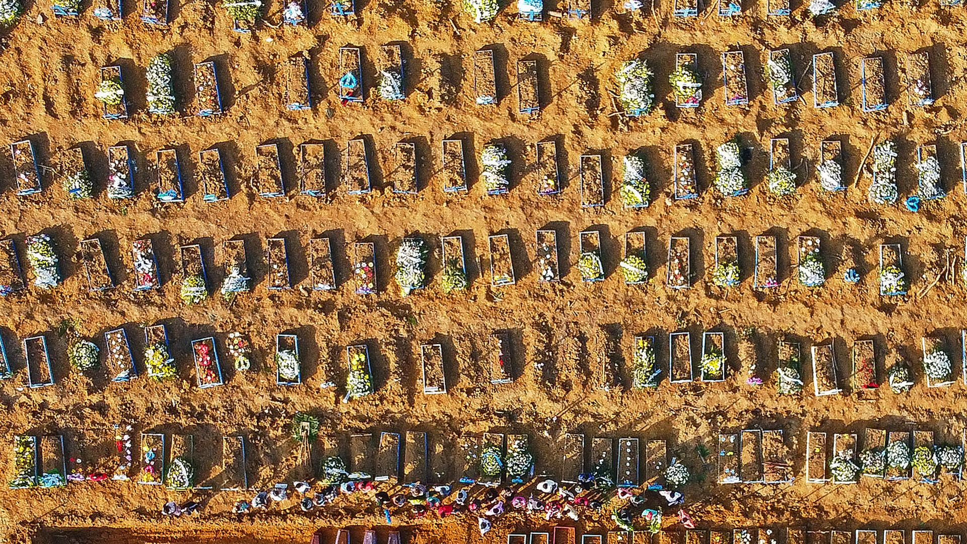An aerial view of coffins at a mass burial in Parque Taruma cemetery, Manaus, Brazil. Graves are being dug at a new area of the cemetery for Covid deaths. - Credit: AFP via Getty Images