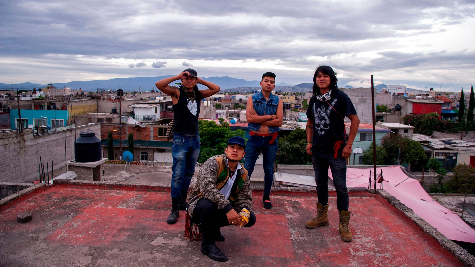 Members of Los Cogelones, the Sandoval Garcia brothers (L-R) Beto, Victor, Gabriel and Marco, in Nezahualcoyotl, which neighbours Mexico City and is home to the world's largest shanty town - Credit: AFP via Getty Images