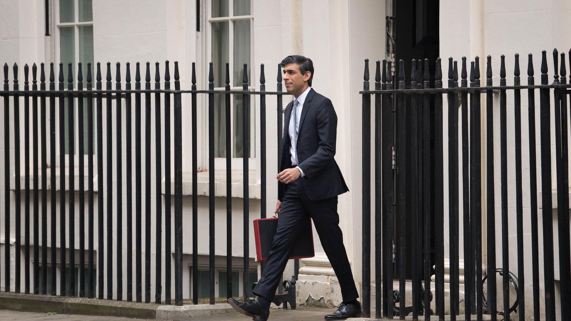 Chancellor of the Exchequer, Rishi Sunak outside 11 Downing Street, London, before heading to the House of Commons to deliver his Budget - Credit: PA