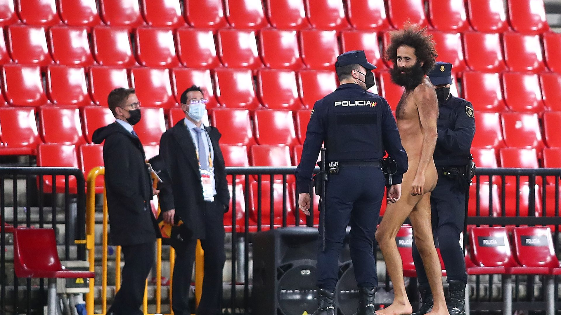 Streaker Olmo Garcia is removed from the pitch during the UEFA Europa League quarter-final first leg match between Granada CF and Manchester United at Los Carmenes on April 08, 2021 - Credit: Photo by Fran Santiago/Getty Images