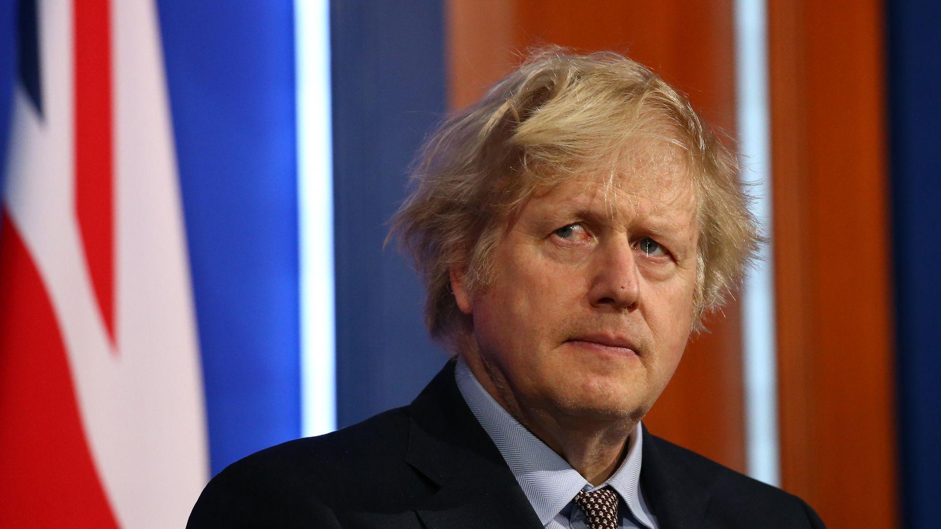 Prime minister Boris Johnson at a media briefing - Credit: PA