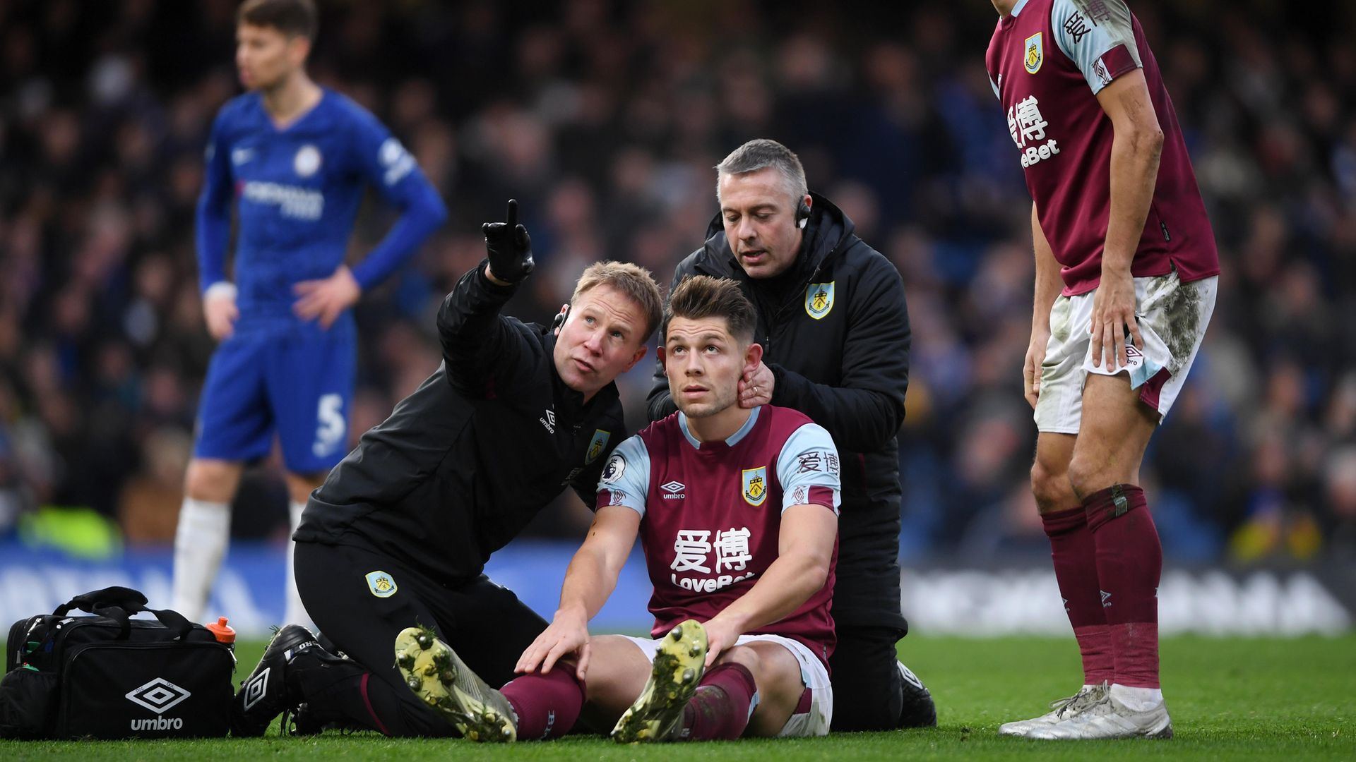 James Tarkowski of Burnley is assessed for concussion during a Premier League match between Chelsea and Burnley in January 2020 - Credit: Photo by Mike Hewitt/Getty Images