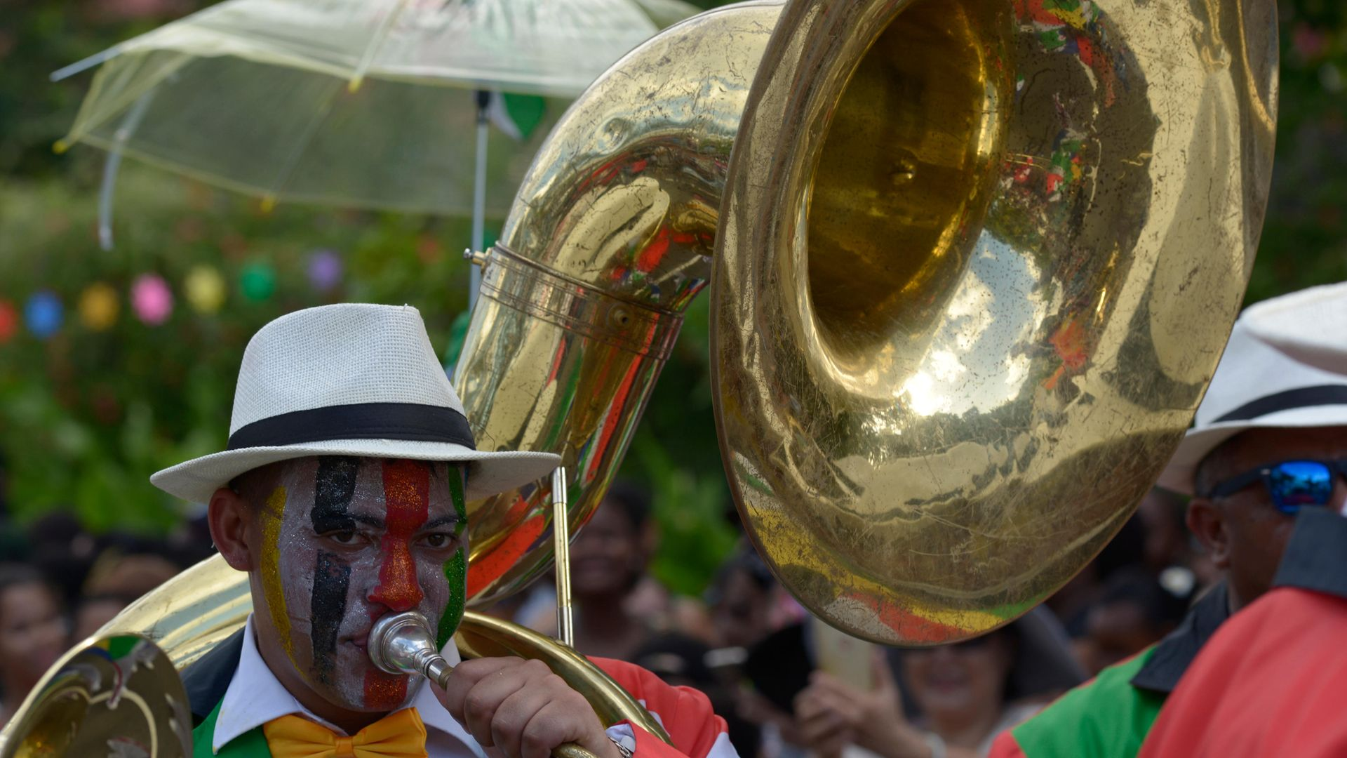 Man wearing a costume playing the tuba, parade at the International Carnival of Victoria, Seychelles. - Credit: De Agostini via Getty Images