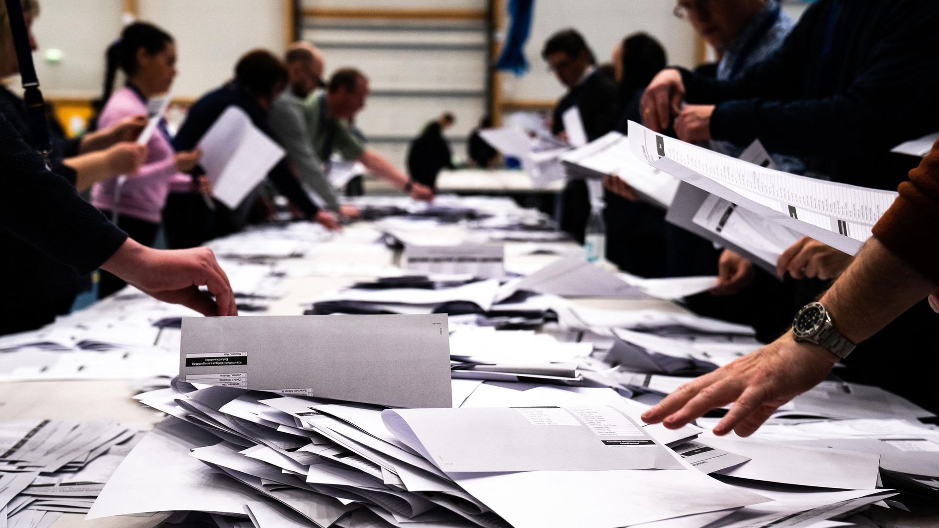 Electoral workers count ballots during elections in Nuuk, Greenland - Credit: Ritzau Scanpix/AFP via Getty Images