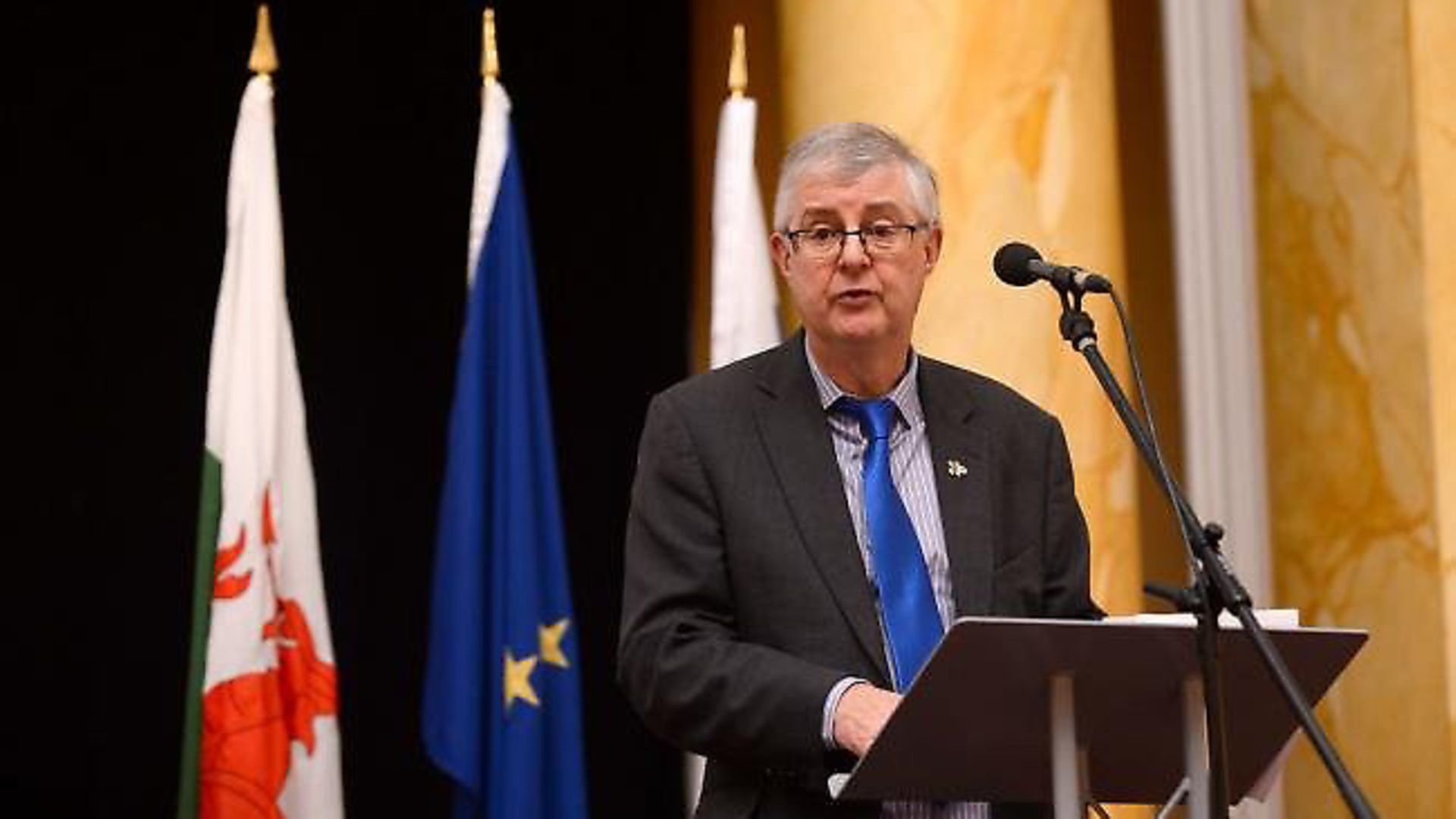 Mark Drakeford appears in front of a European flag. Photograph: CPMR/Flickr. - Credit: Archant