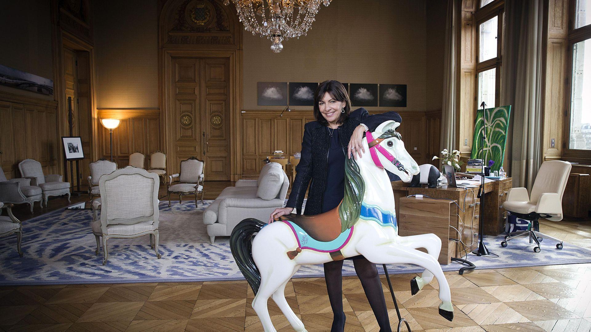 Paris mayor Anne Hidalgo in her City Hall office, in 2015 - Credit: AFP via Getty Images