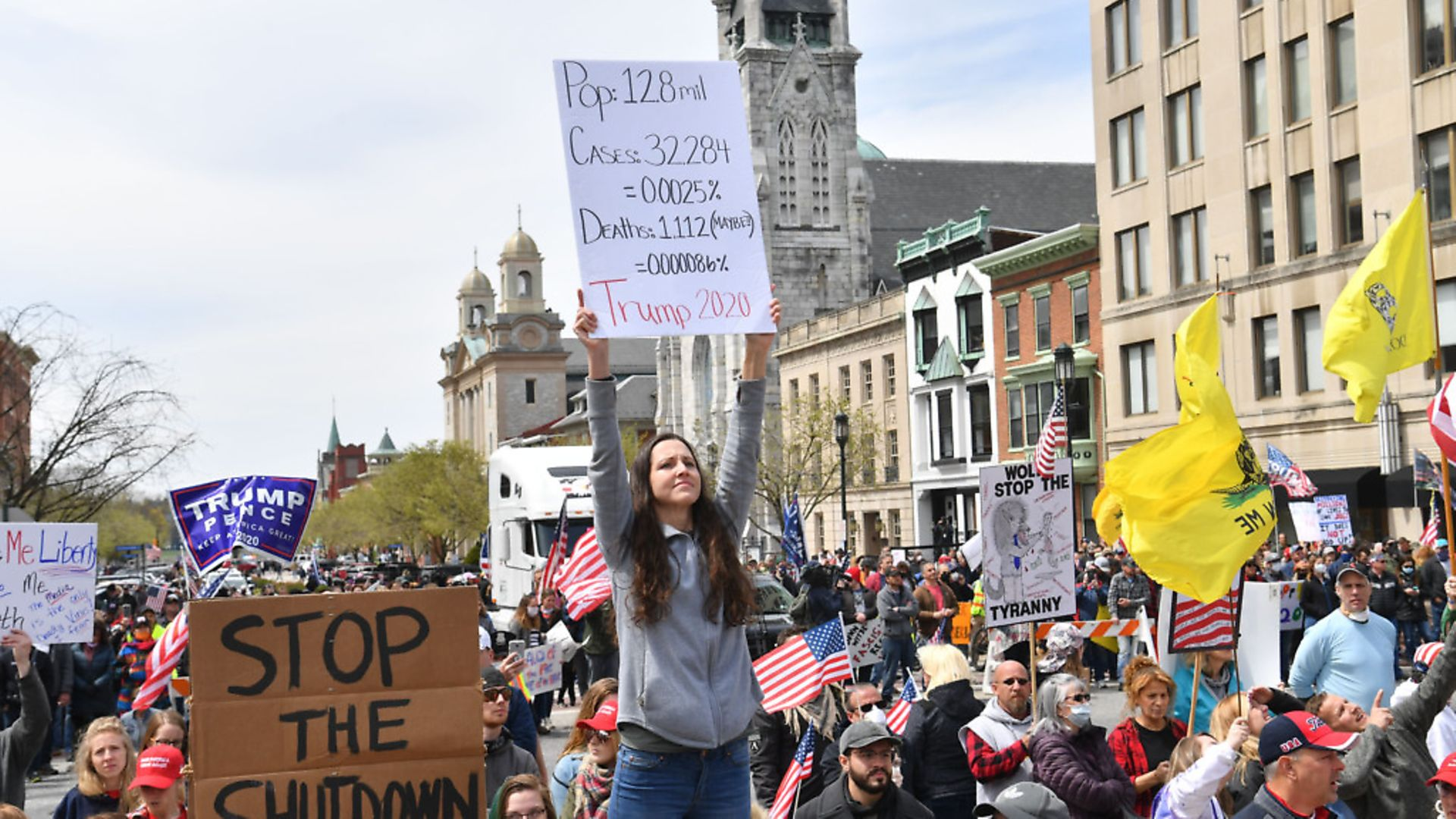 """Protestors take part in a """"reopen"""" Pennsylvania demonstration on April 20, 2020, in Harrisburg, Pennsylvania. Picture: Getty Images - Credit: AFP via Getty Images"""