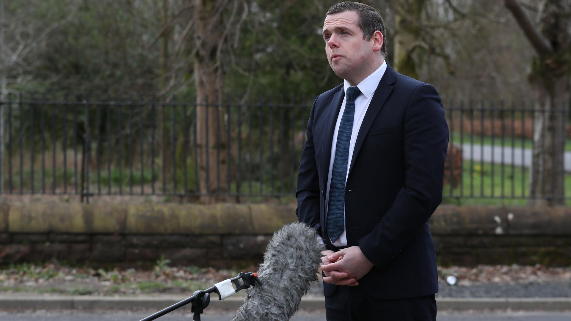 Scottish Conservative Leader Douglas Ross said Boris Johnson's absence from campaigning in Scotland is due to Covid restrictions - Credit: PA