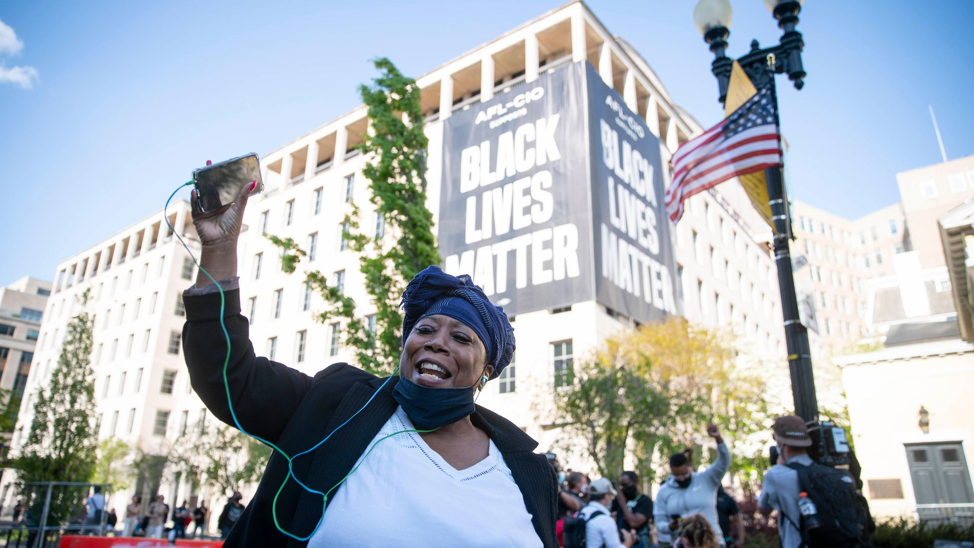 A person celebrates the verdict of the Derek Chauvin trial at Black Lives Matter Plaza near the White House - Credit: Getty Images