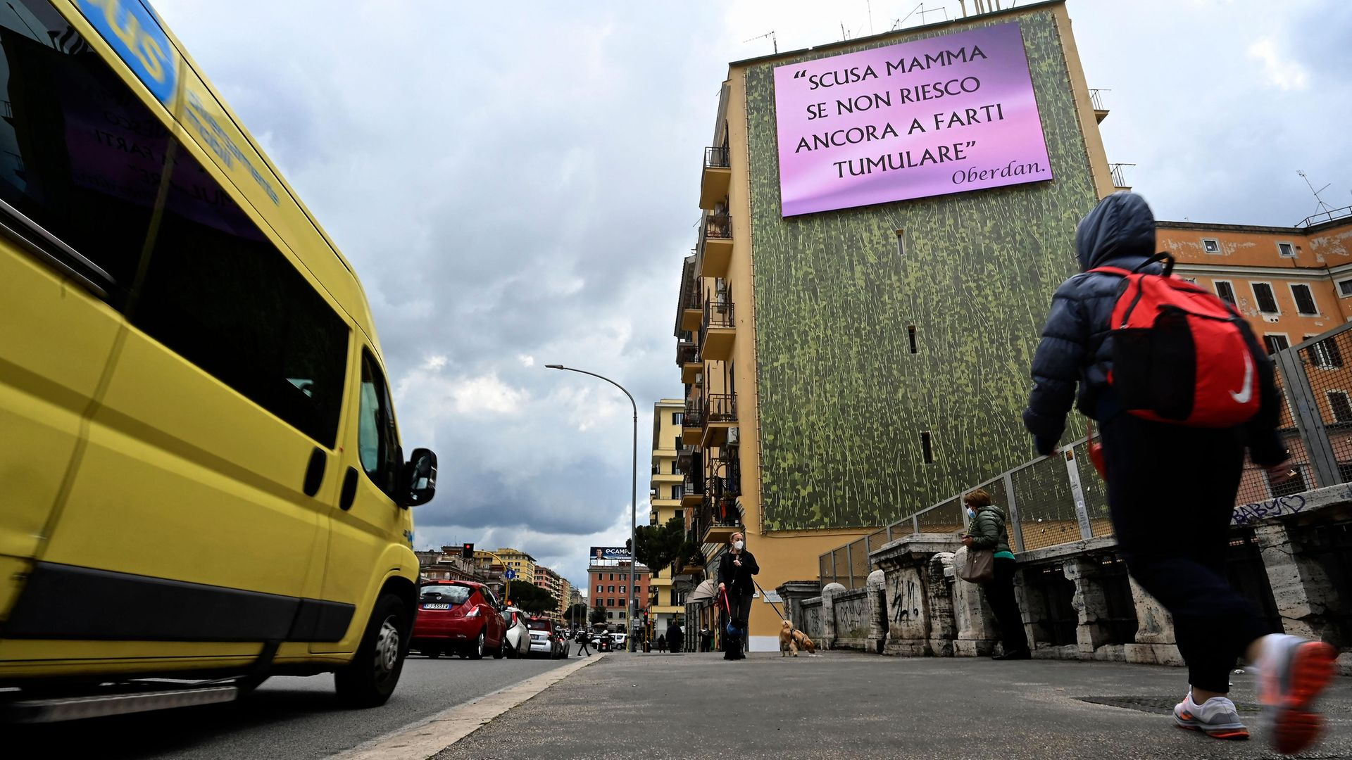 """The Rome advertising boards put up by Oberdan Zuccaroli in protest at not being able to bury his mother. The message reads """"Mum, I'm sorry I've not been able to have you buried yet"""" - Credit: Photo by Alberto Pizzoli/AFP via Getty Images"""