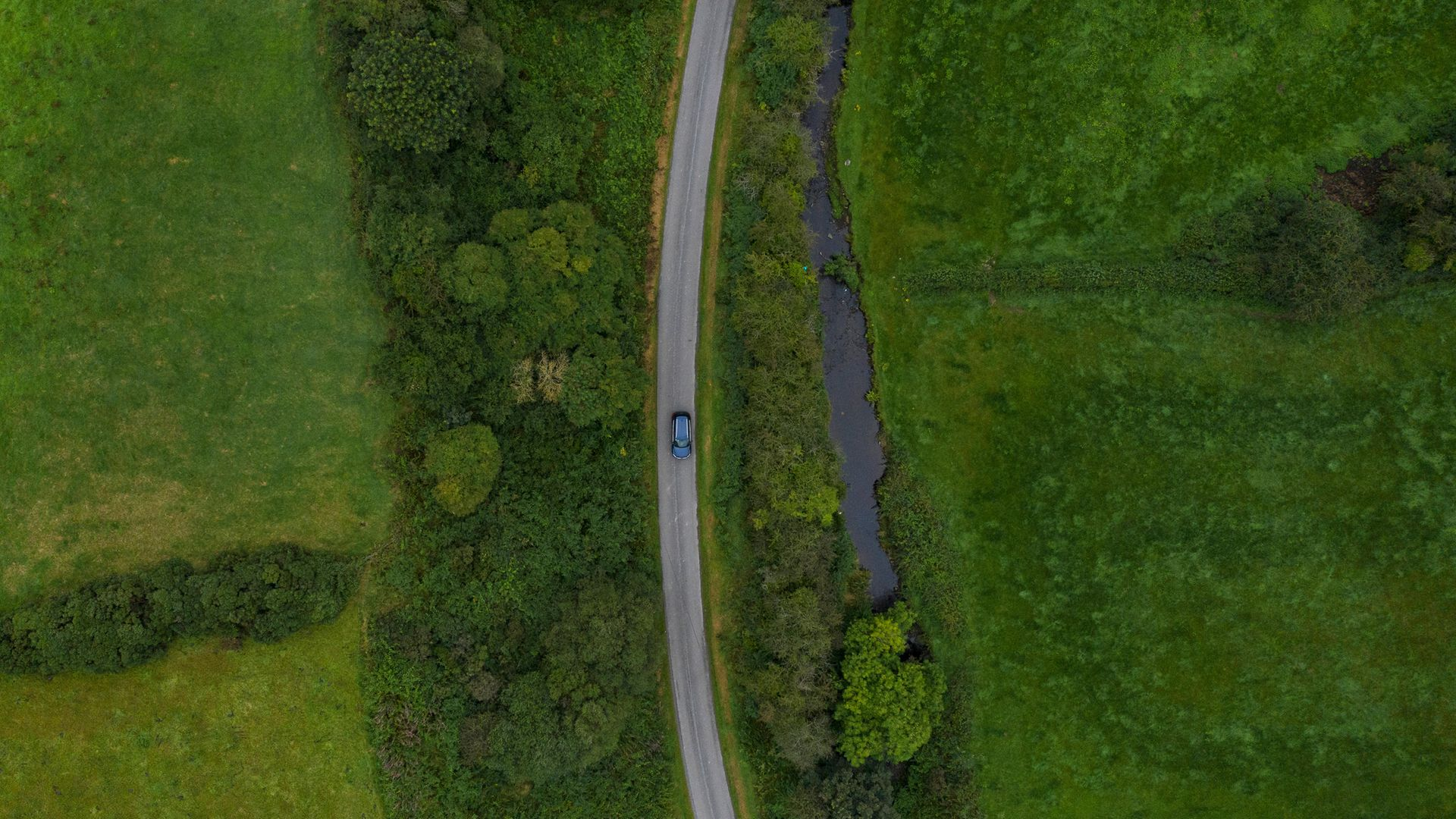 A road runs along a stream that marks the border between Northern Ireland (left) and Ireland, at Castleblayney - Credit: Getty Images