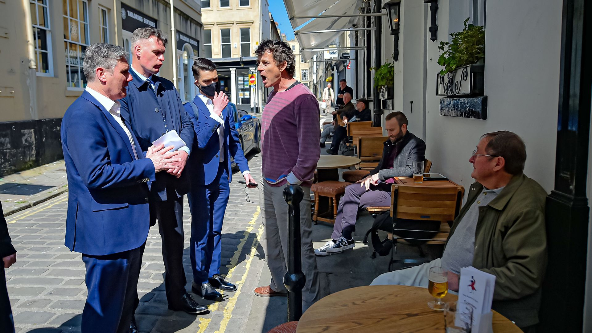 Labour leader Sir Keir Starmer listens to Rod Humphris,  The Raven pub in Bath, shout at him on Monday April 19, 2021 - Credit: Ben Birchall/PA Wire/PA Images