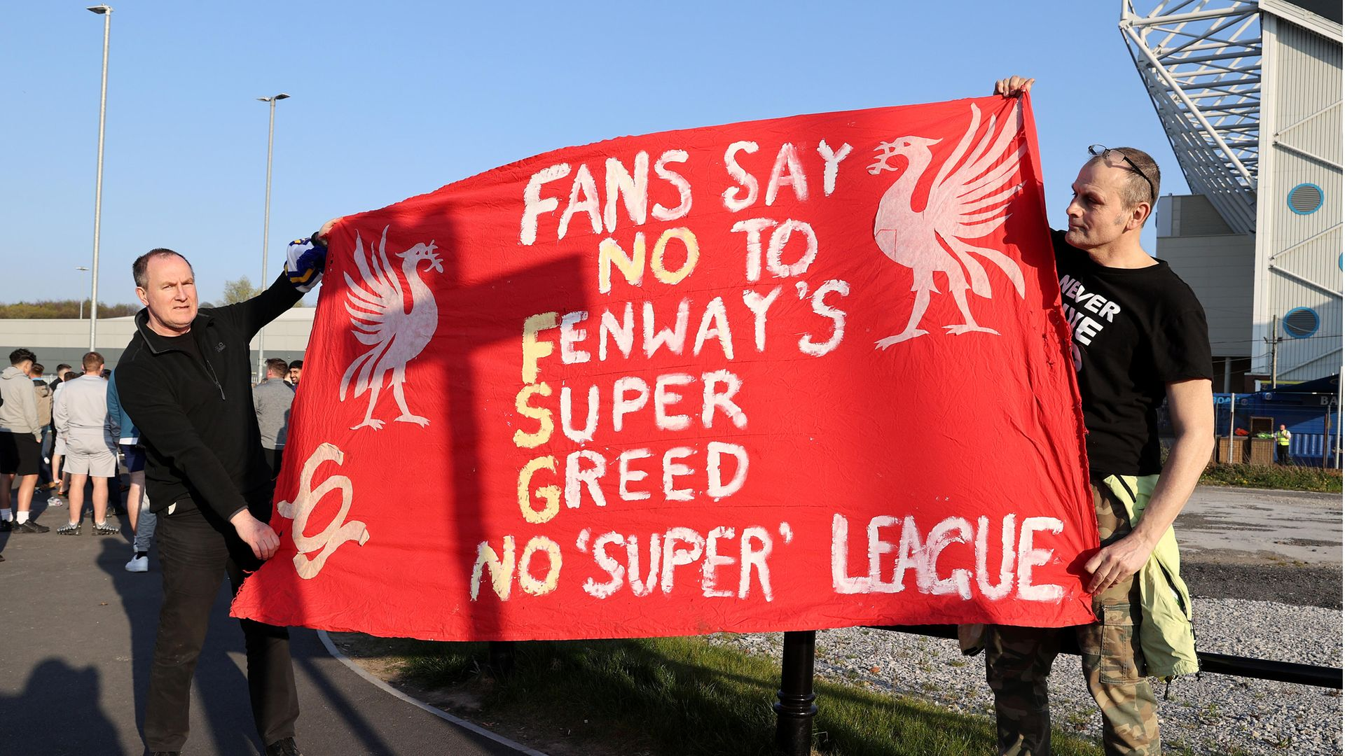 Liverpool fans hold up a protest banner against the European Super League outside Elland Road on April 19, 2021 in Leeds - Credit: Photo by Clive Brunskill/Getty Images