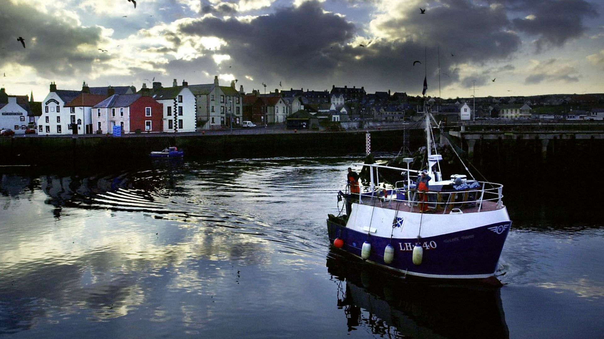 A trawler brings in its catch at Eyemouth harbour, in the Scottish Borders - Credit: PA