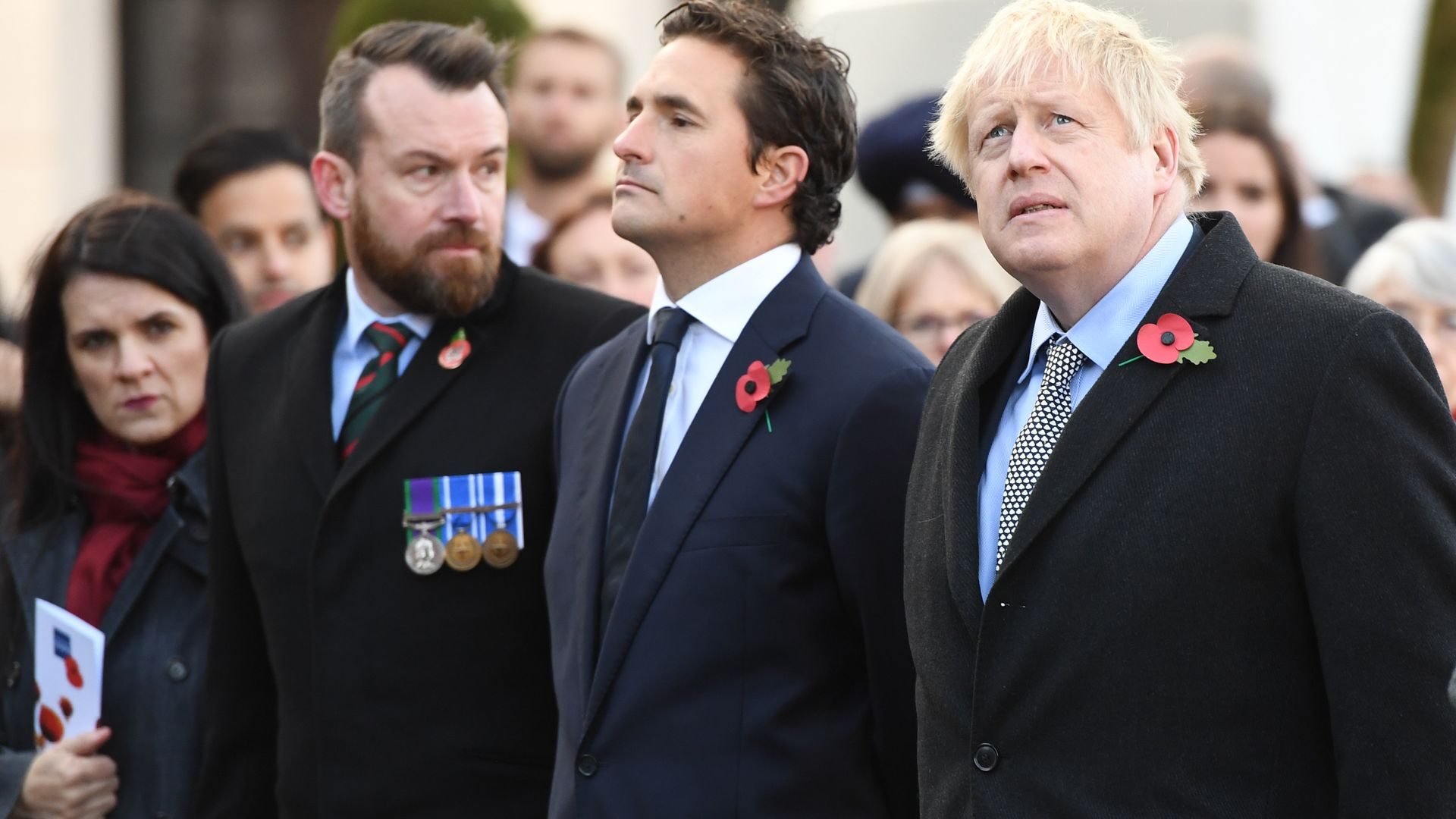 Prime minister Boris Johnson (right) and former defence minister Johnny Mercer (centre) during a service at the cenotaph in St Peter's Square, Wolverhampton, to mark Armistice Day in 2019 - Credit: PA