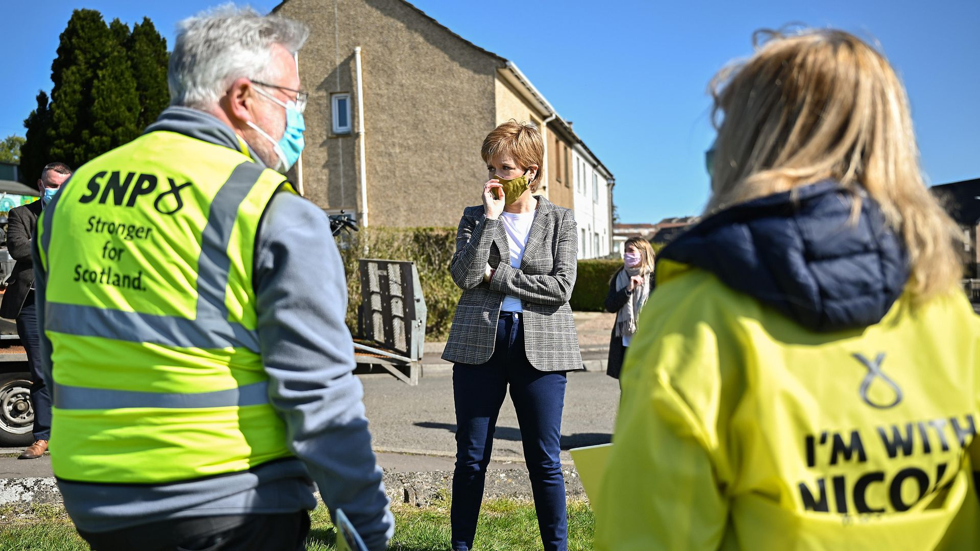 First minister Nicola Sturgeon speaks to Scottish National Party (SNP) volunteers in Dumbarton, West Dunbartonshire, during campaigning for the Scottish Parliamentary election - Credit: PA