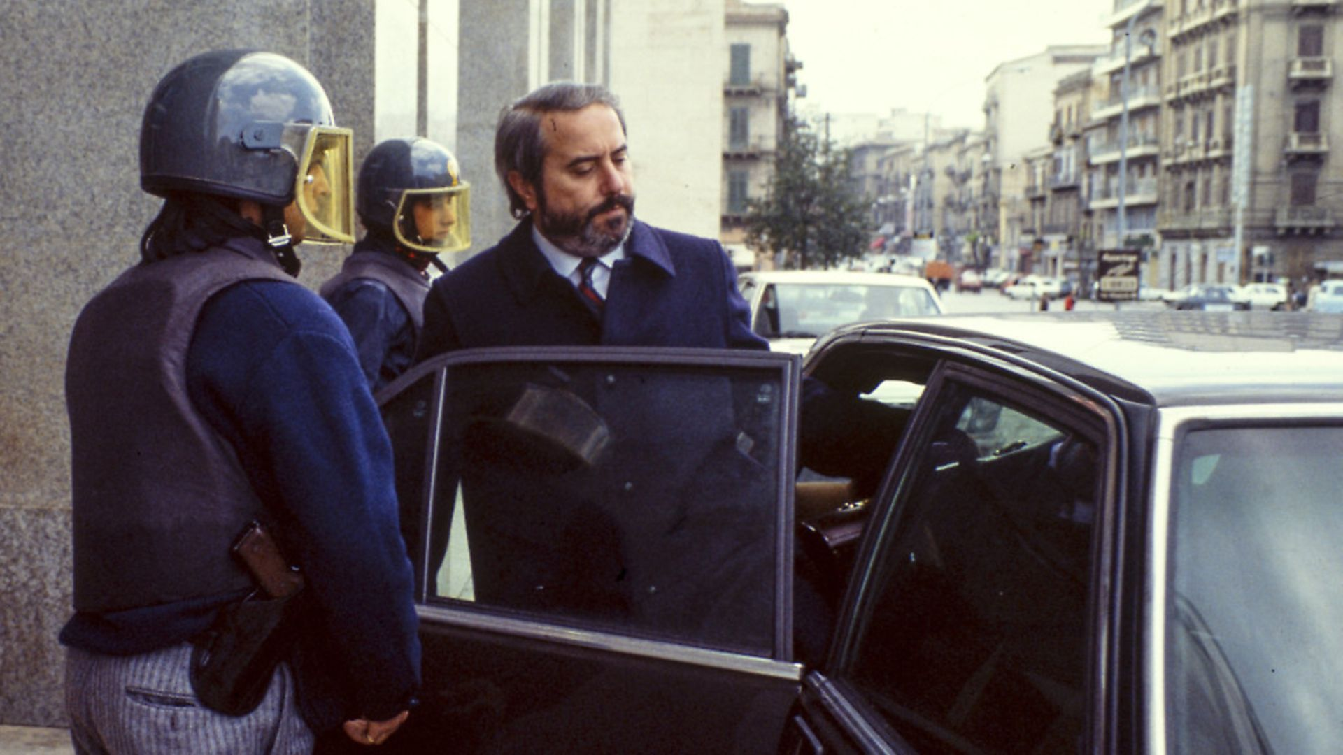 The Italian judge Giovanni Falcone is escorted by police out of the Court of Palermo, Italy, on May 16, 1985. Giovanni Falcone was killed by the Mafia in 1992. Photo: Vittoriano Rastelli/Corbis via Getty Images - Credit: Getty Images