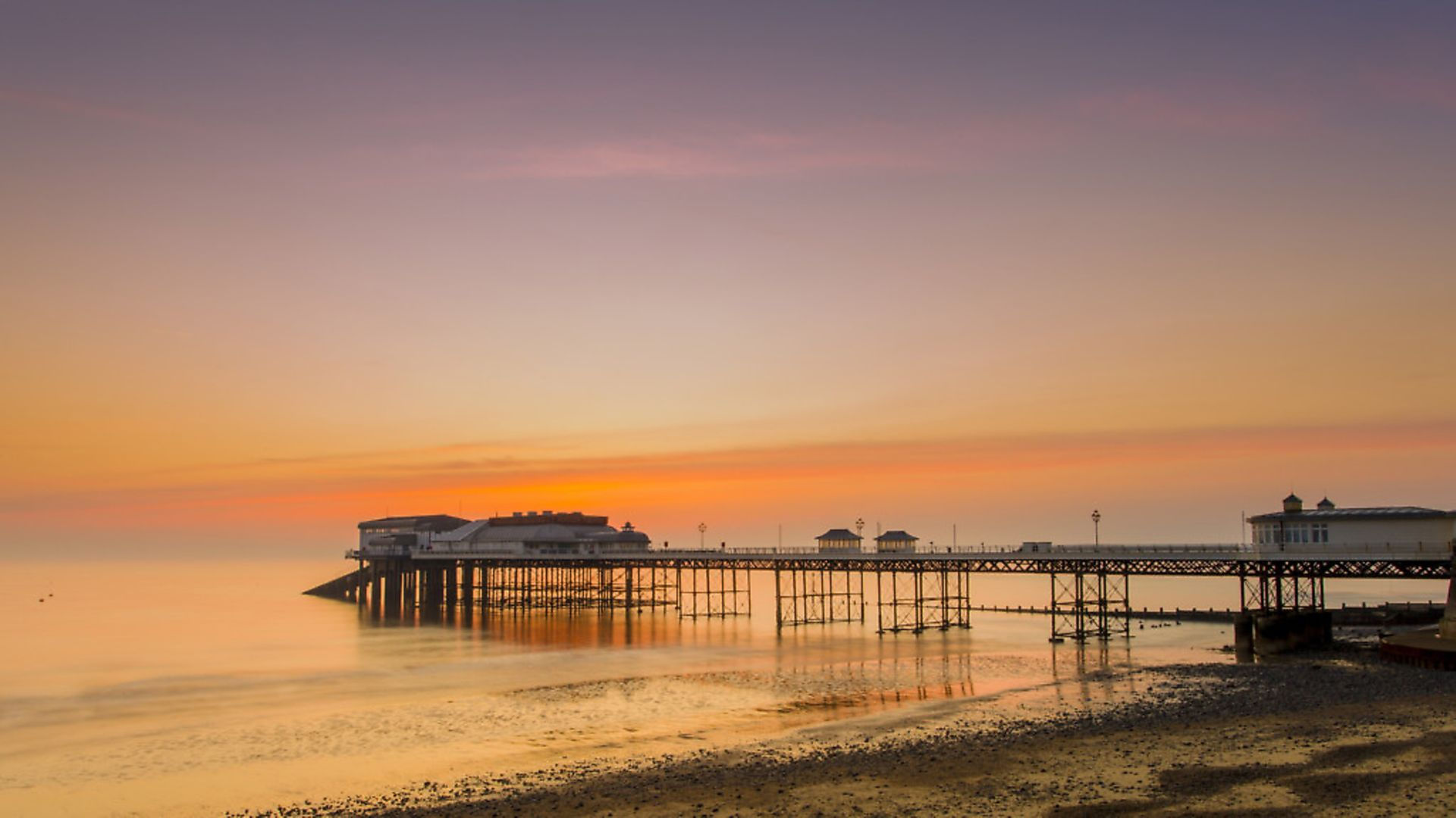 Timeless: Cromer pier at sunrise. (Photo by: Loop Images/Universal Images Group via Getty Images) - Credit: Universal Images Group via Getty