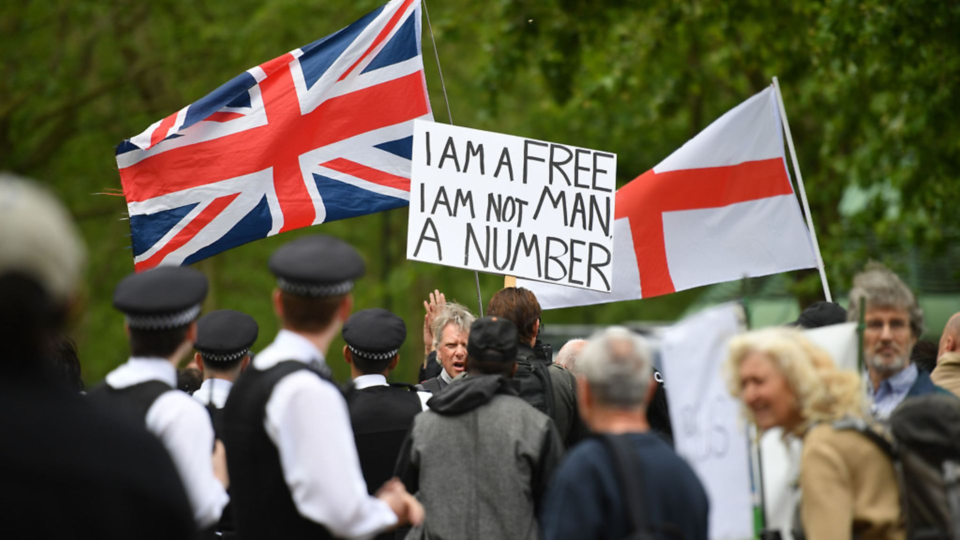 Police attend an anti-coronavirus lockdown demonstration with protesters in London's Hyde Park. Picture: Getty Images - Credit: AFP via Getty Images