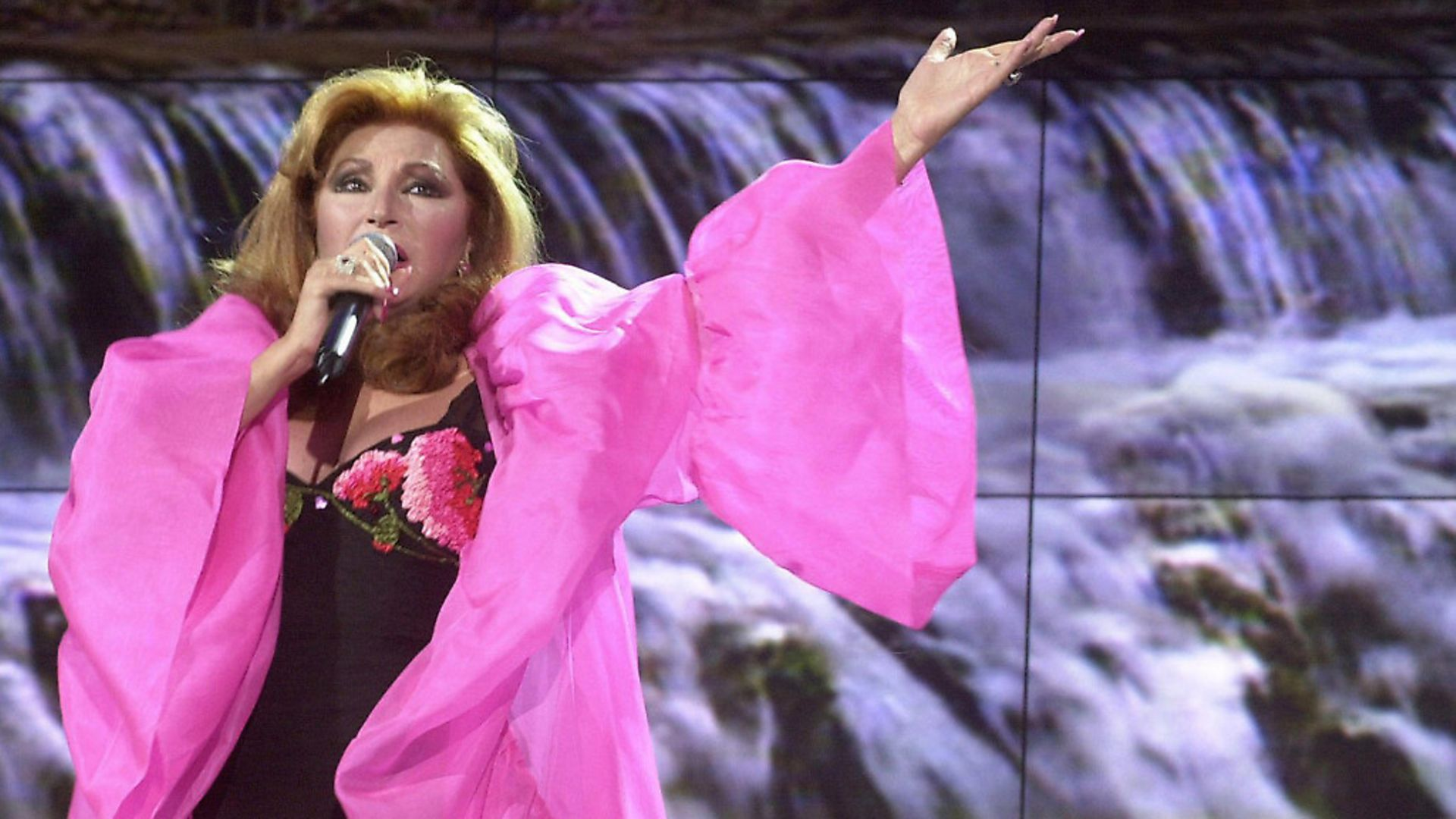 Spanish singer Rocio Jurado performing during a programme on Spanish television. Picture: RAFAEL BRAVO/AFP via Getty Images - Credit: AFP via Getty Images