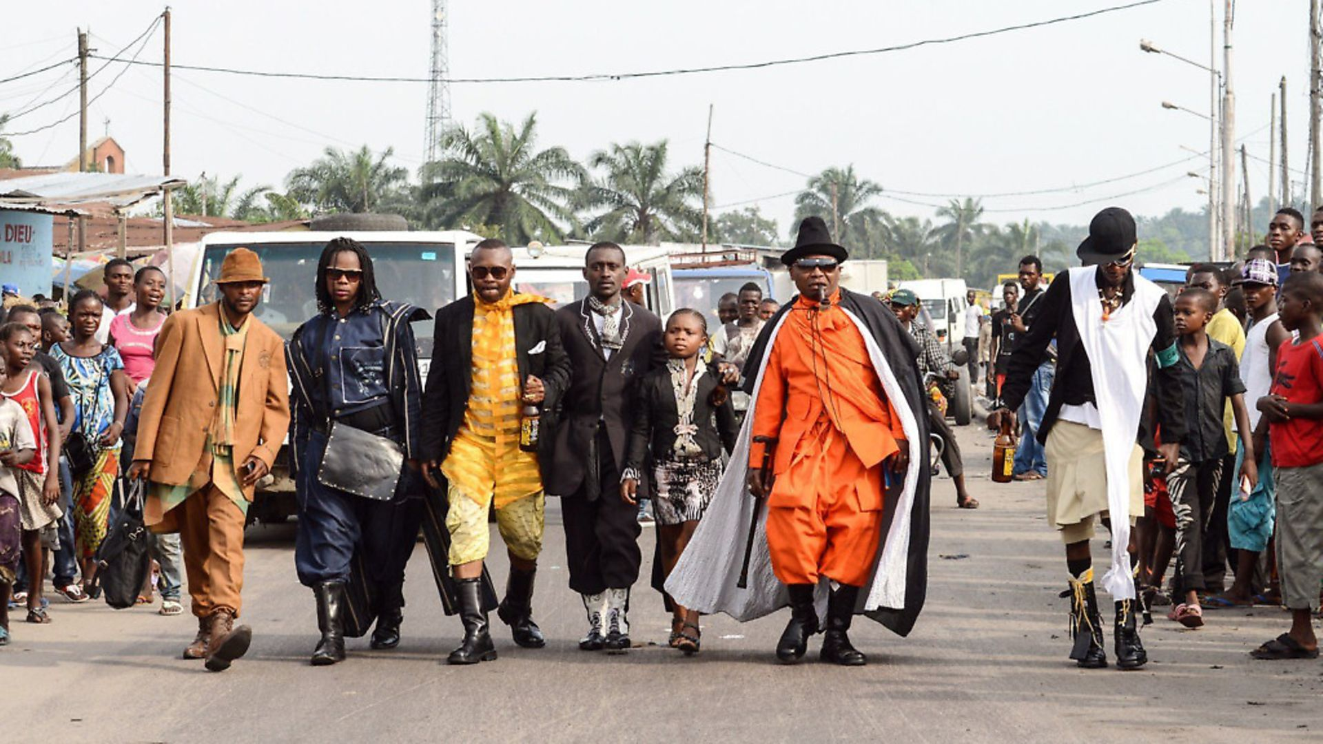 Adherents of La Sape (an abbreviation of The Society for the Advancement of Elegant People pose in Kinshasa) . Photo: Junior D. Kannah/AFP via Getty Images - Credit: AFP via Getty Images