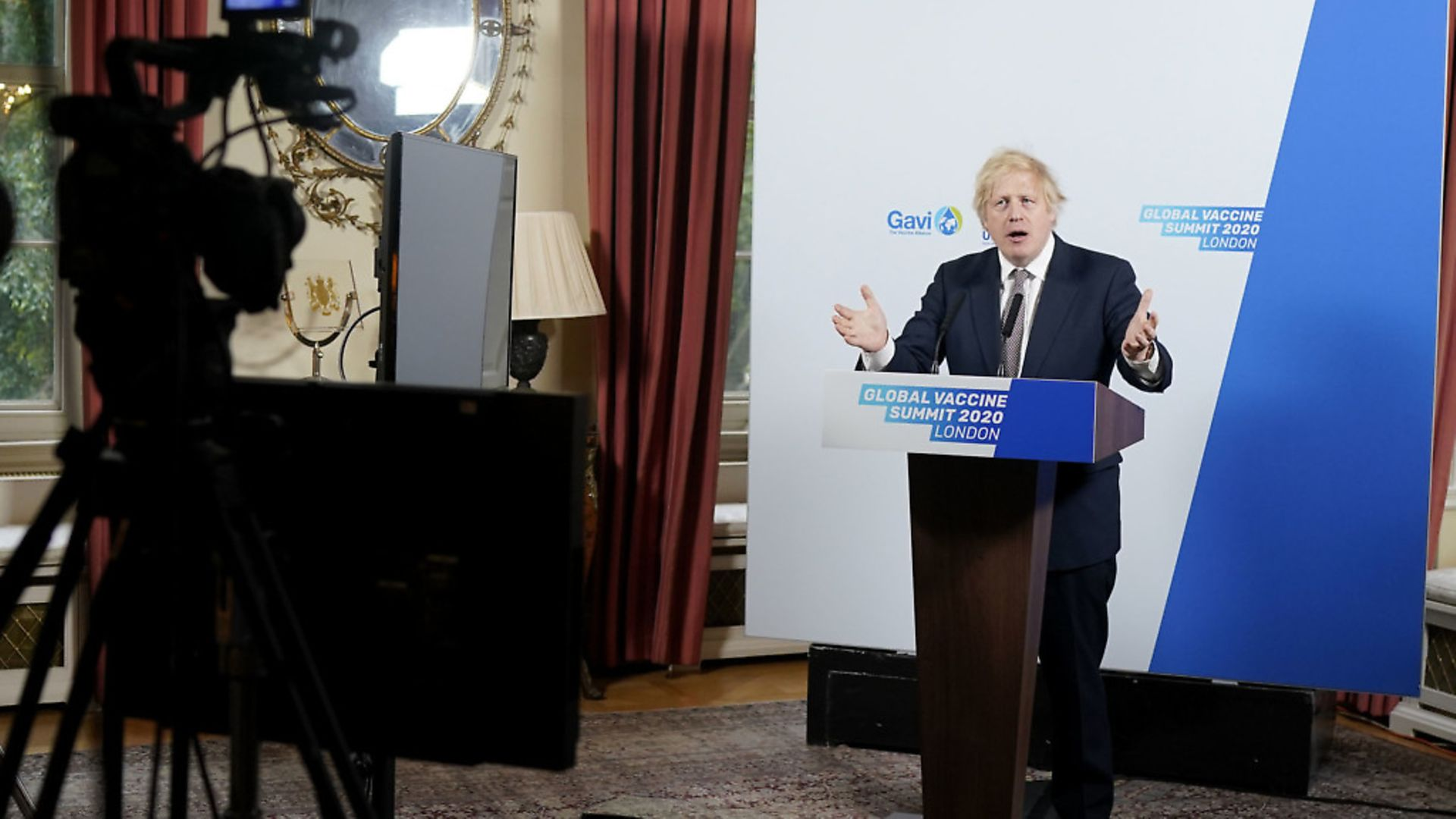 Prime Minister Boris Johnson delivering a speech to the Global Vaccine Summit from the White Room of No10 Downing Street. Photograph: Andrew Parsons/10 Downing Street/Crown Copyright/PA Wire. - Credit: PA